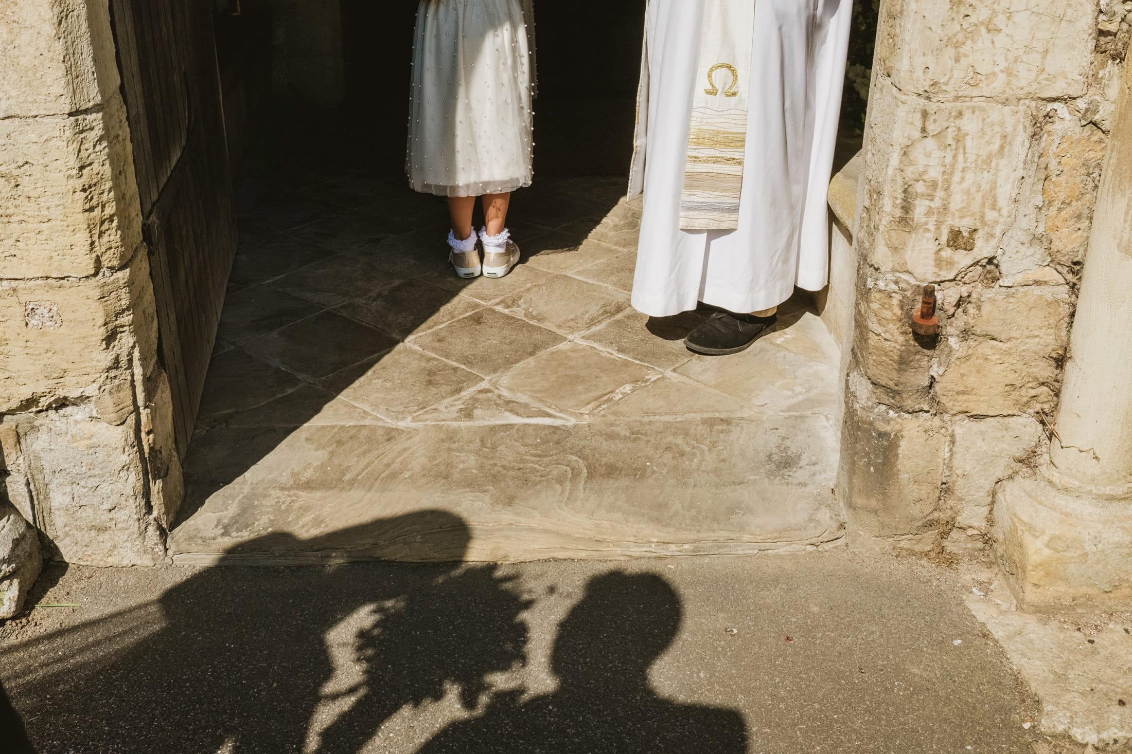 bride waiting to go into the church, shadows on the floor