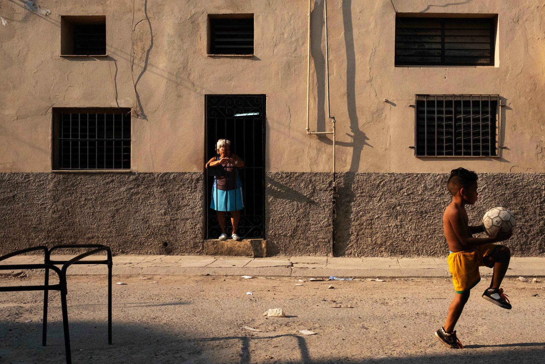 little boy balancing a football in Cuba, Havana