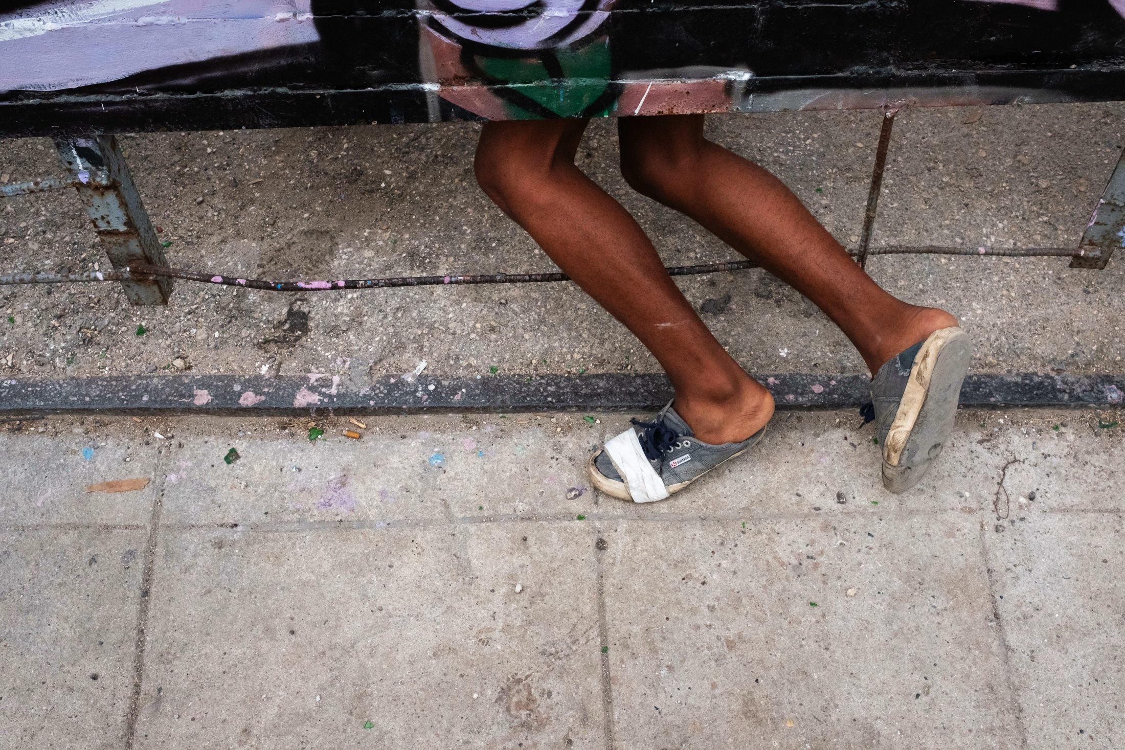 legs underneath a building