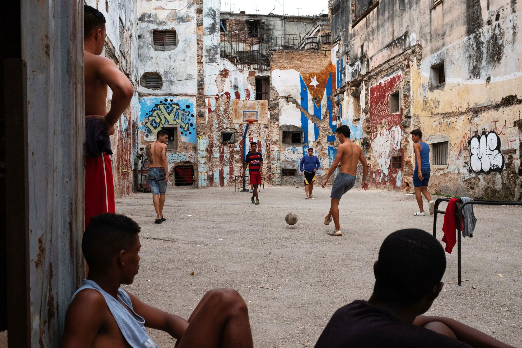 boys playing football in a yard in Havana