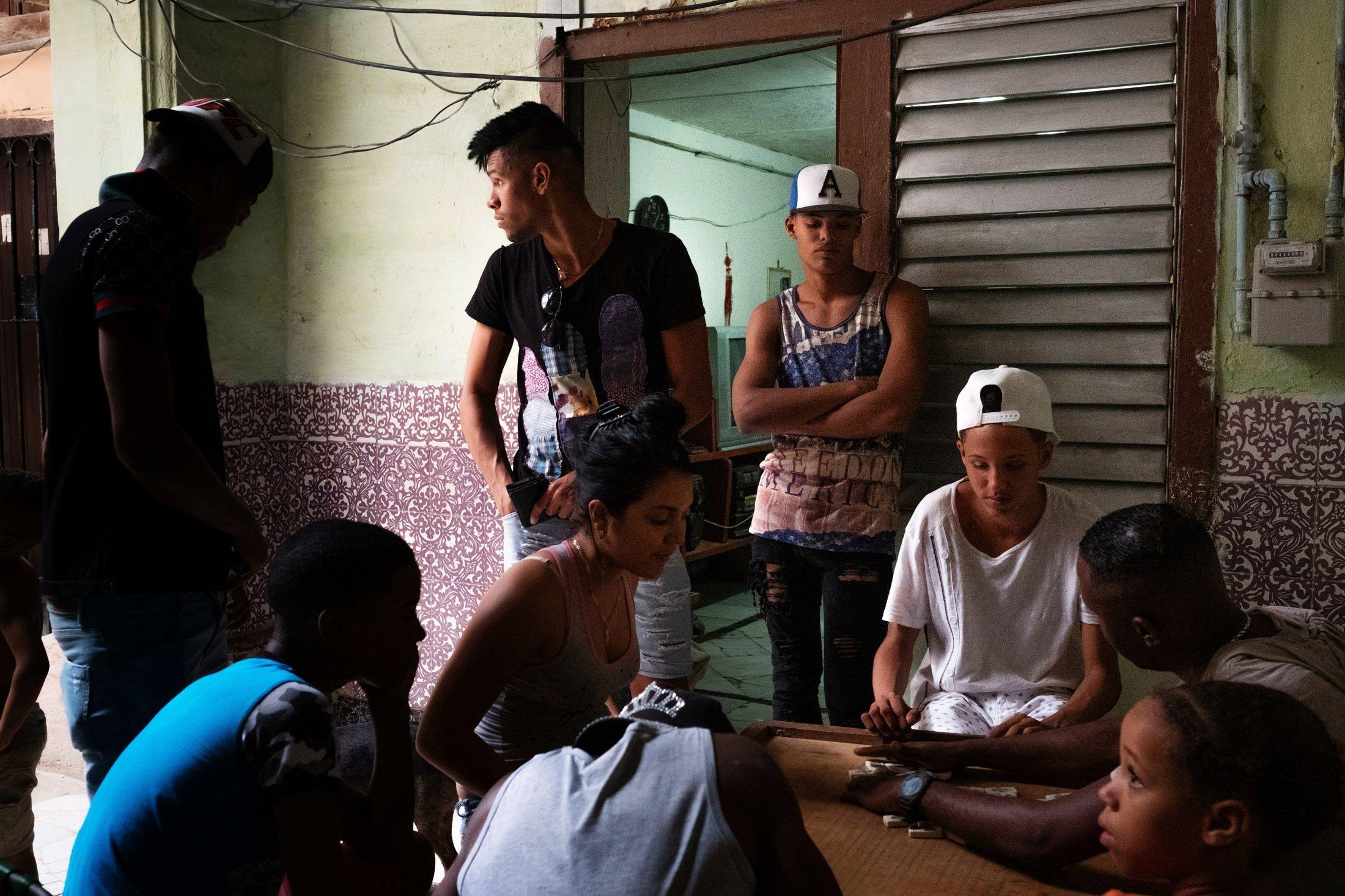 men playing dominos in their house in Havana, Cuba
