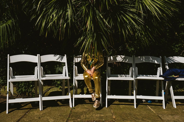 Pump House Battersea Park boy ninja in gold hidden by a tree