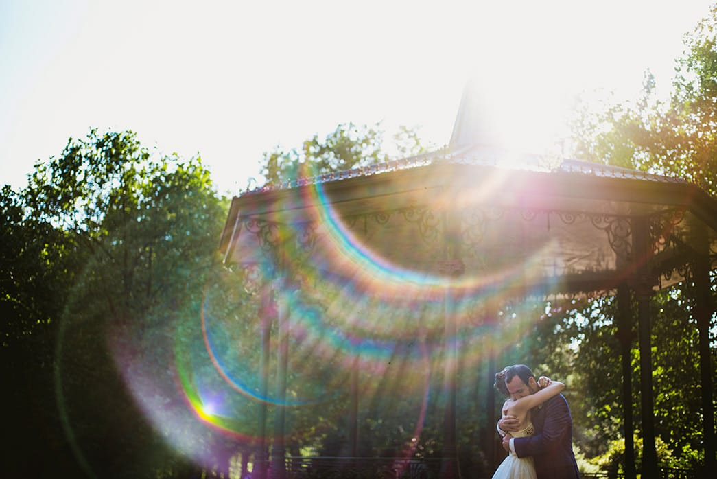 Pump House Battersea Park bride and groom portraits sun flare through lens