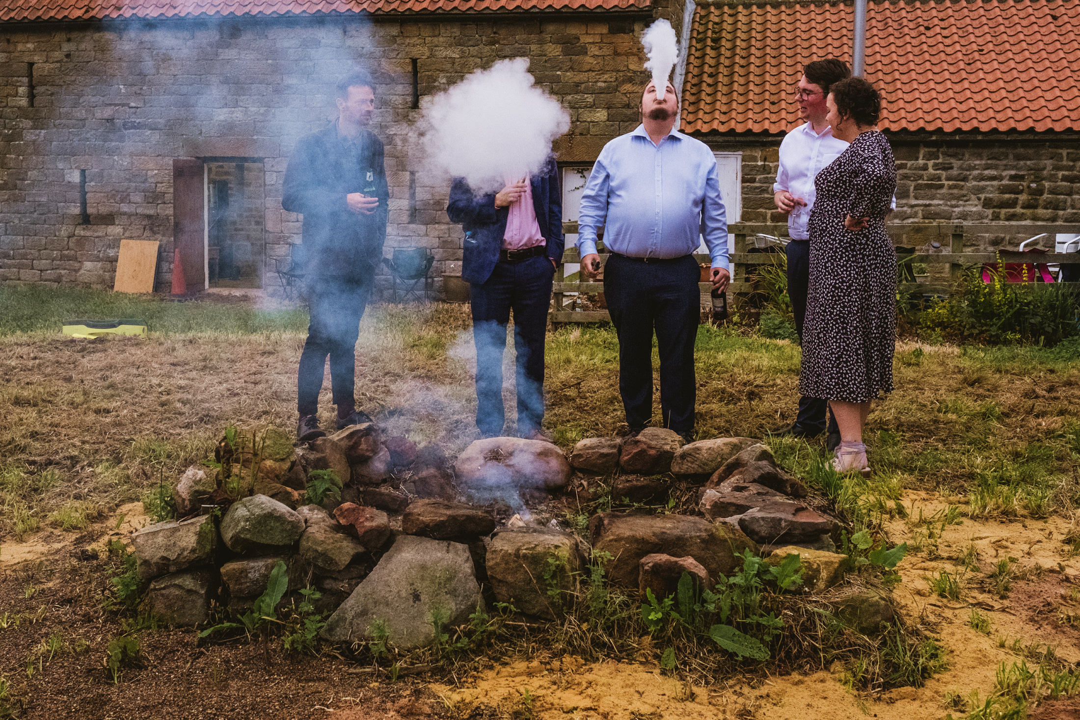 Guests smoking at Robin's Hood Bay reception