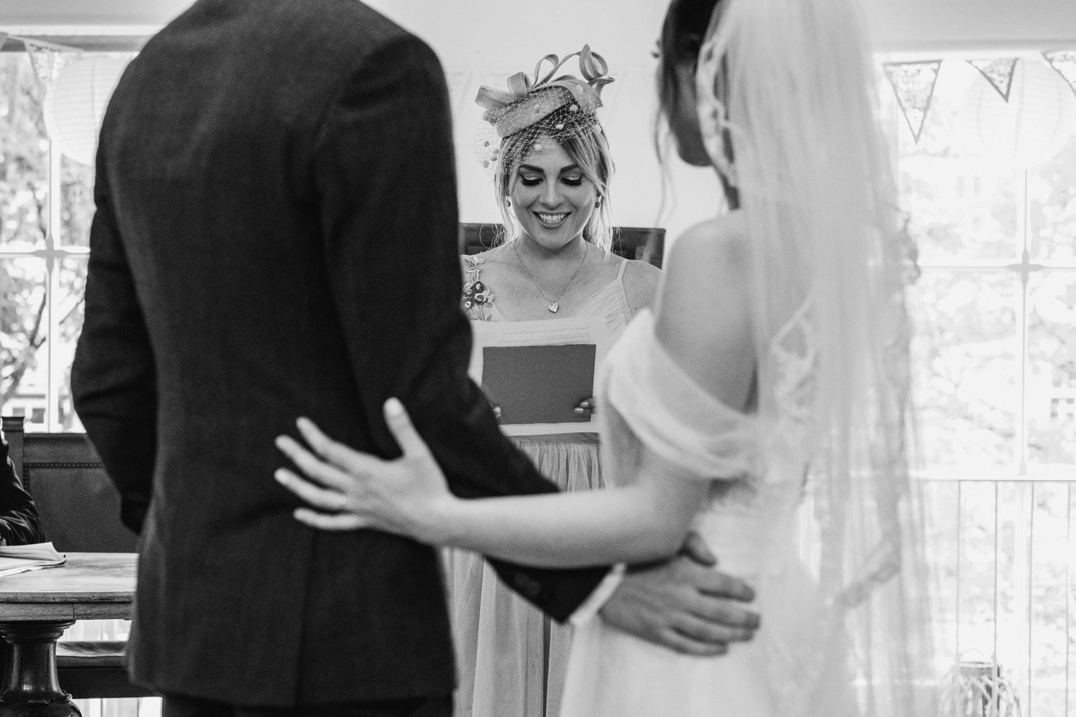Black and white photo of the reading with bride and groom hugging