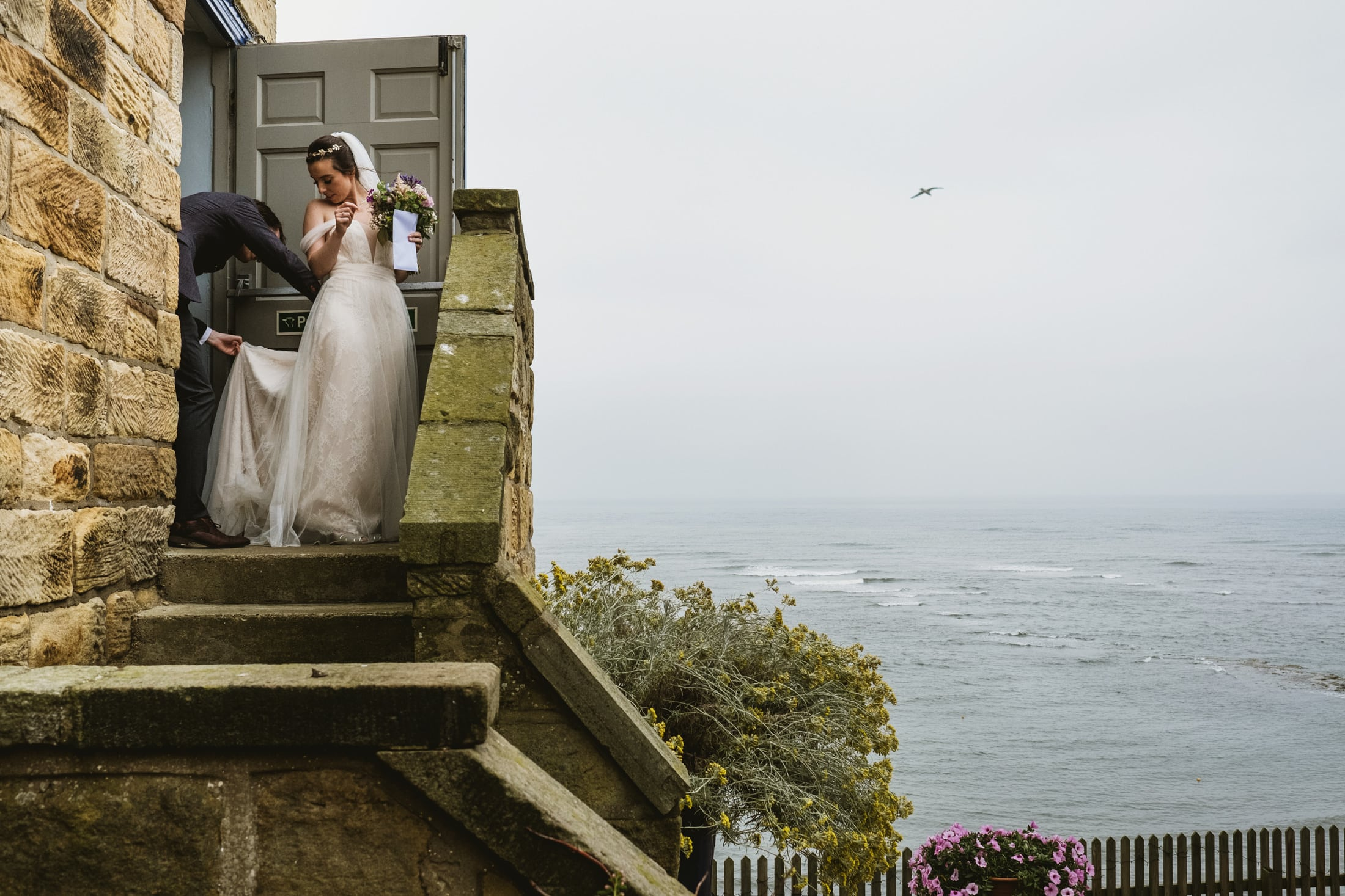 Bride and groom leaving the ceremony at Robin's Hood Bay