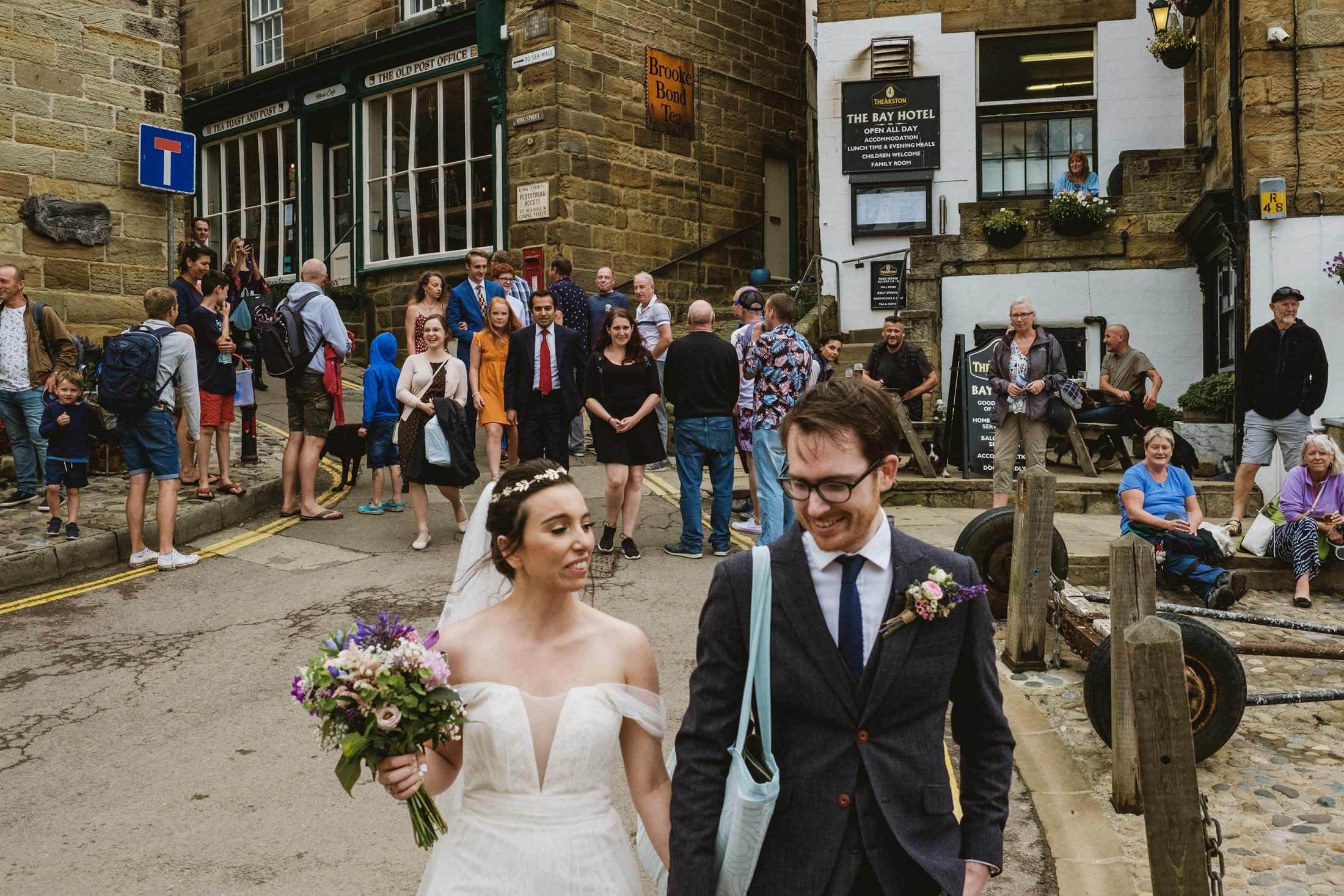 Bride and Groom walking at Robin's Hood Bay