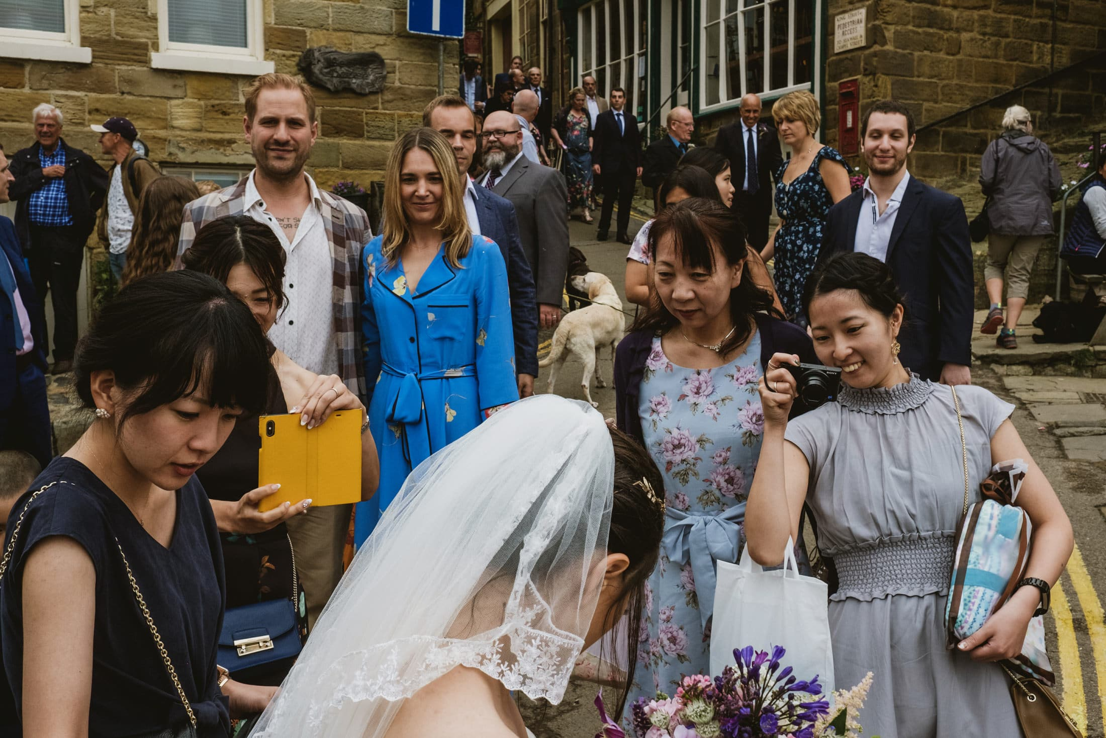 Bride and guests at Robin's Hood Bay