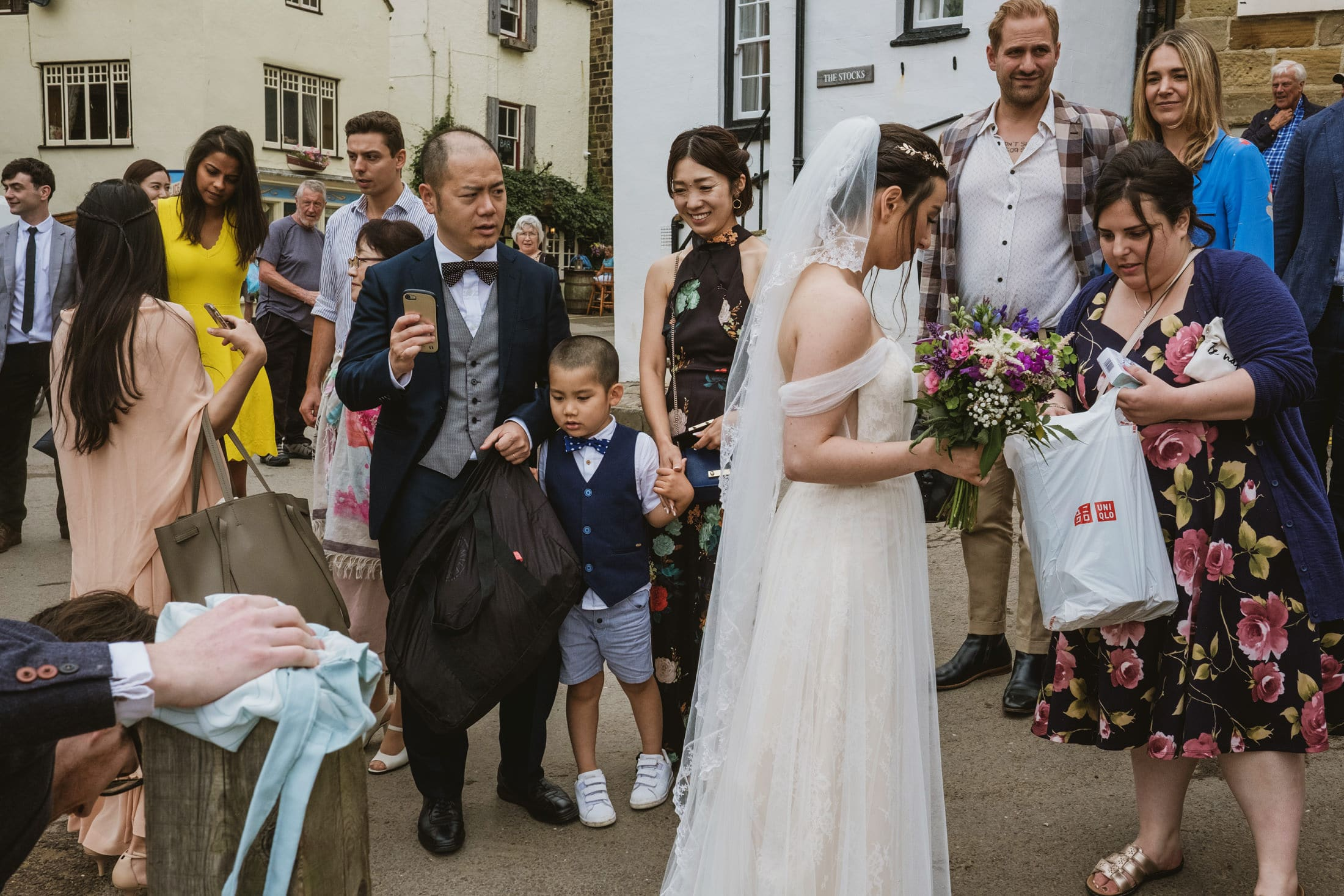 Bride and groom and guests at Robin's Hood Bay