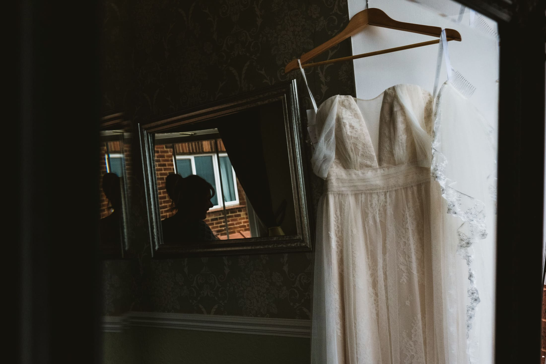 Wedding dress and silhouette in mirror