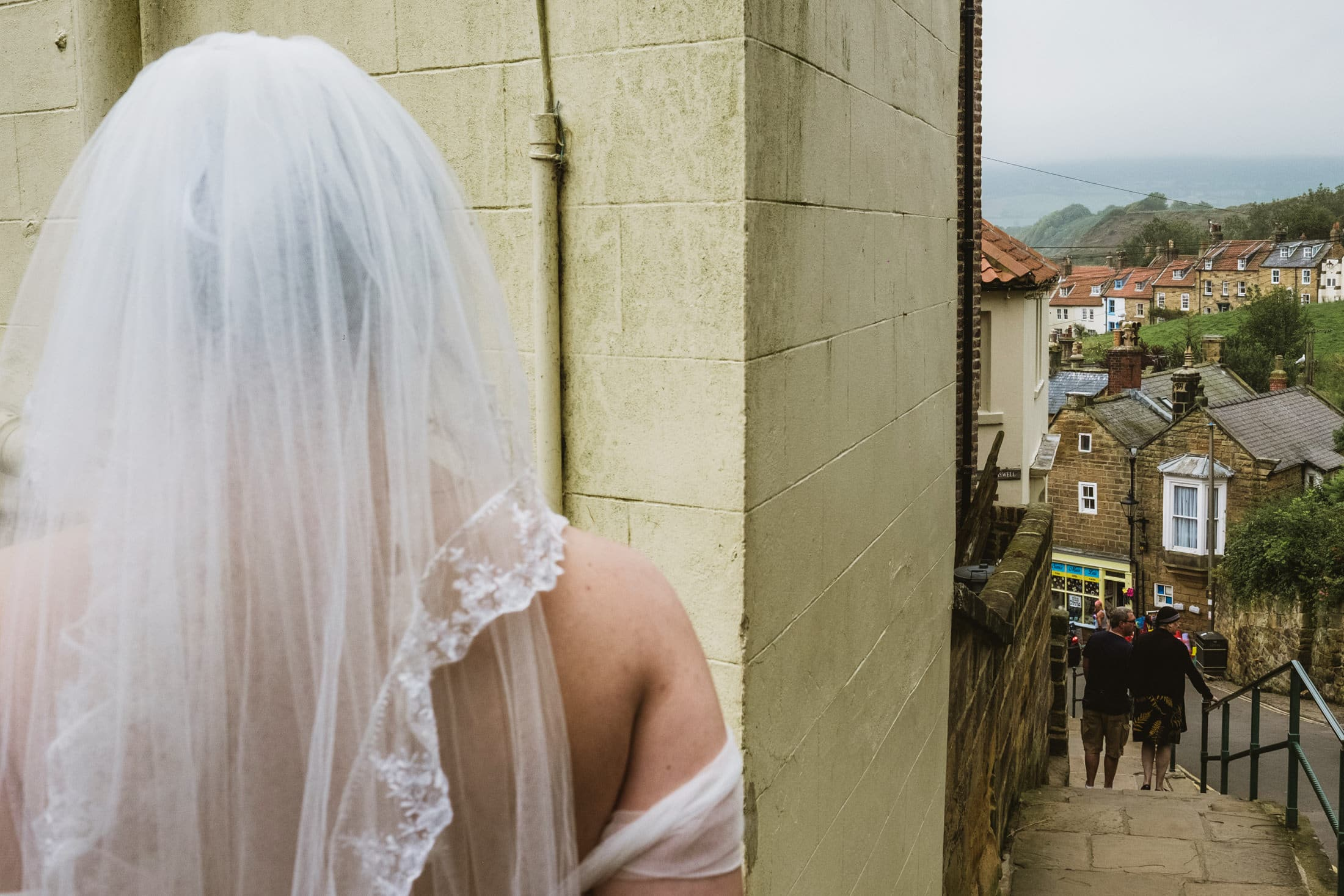 Bride walking to the Swell Cafe, Robin's Hood Bay