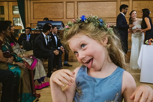 Signing the registry at Cecil Sharp House with a little girl pulling faces