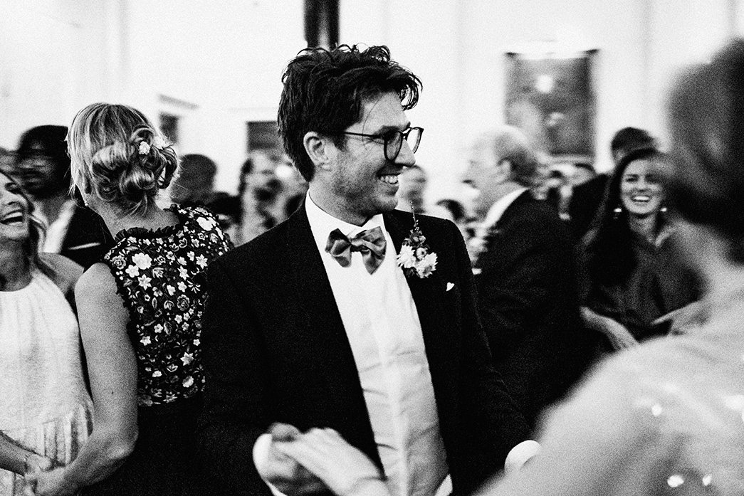 The Ned black and white groom dancing movement blur