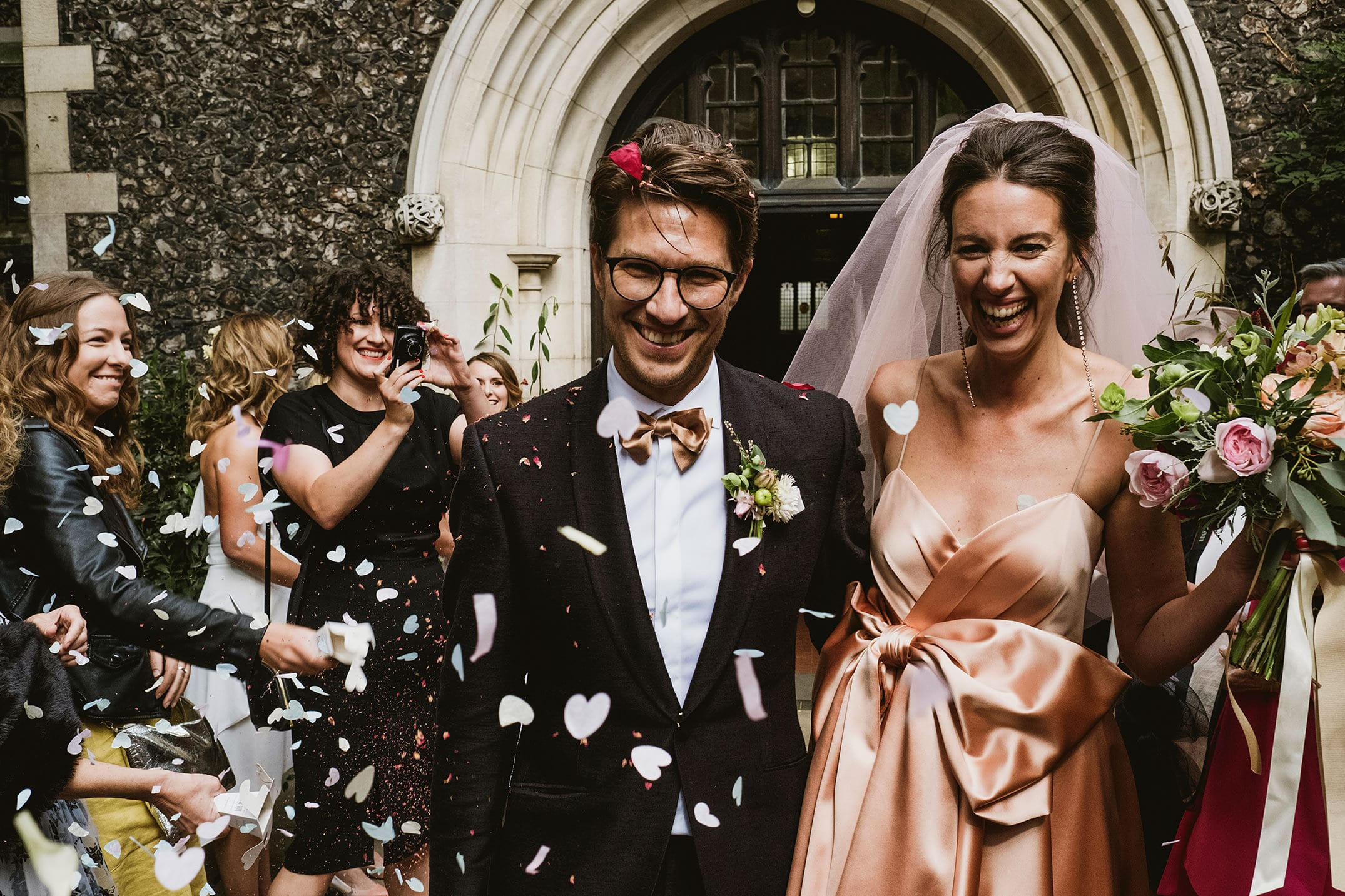 The Ned in London confetti with the bride and groom. Gucci wedding dress.