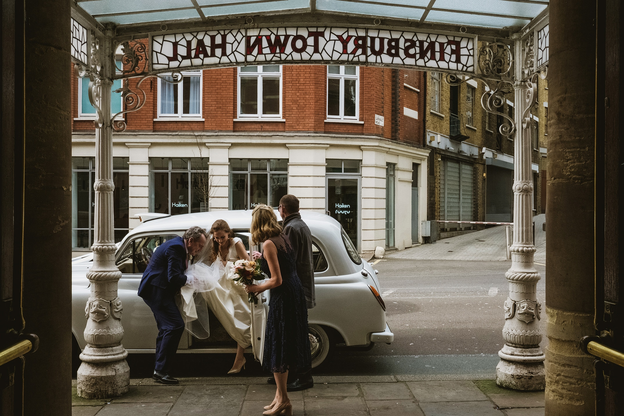 The Old Finsbury Town Hall Wedding Photography London bride coming out the wedding car