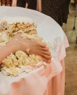 unusual wedding cake photo squashed fake foot in the cake