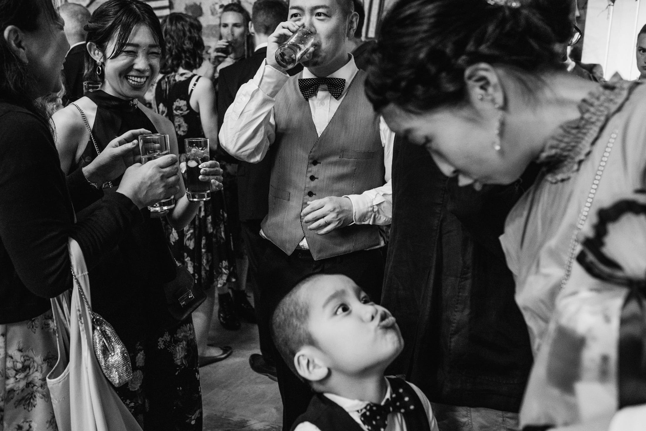little wedding guest pulling faces