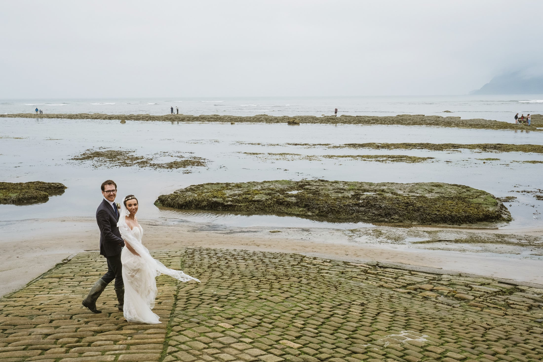 Bride and groom on the Robin's Hood Bay beach