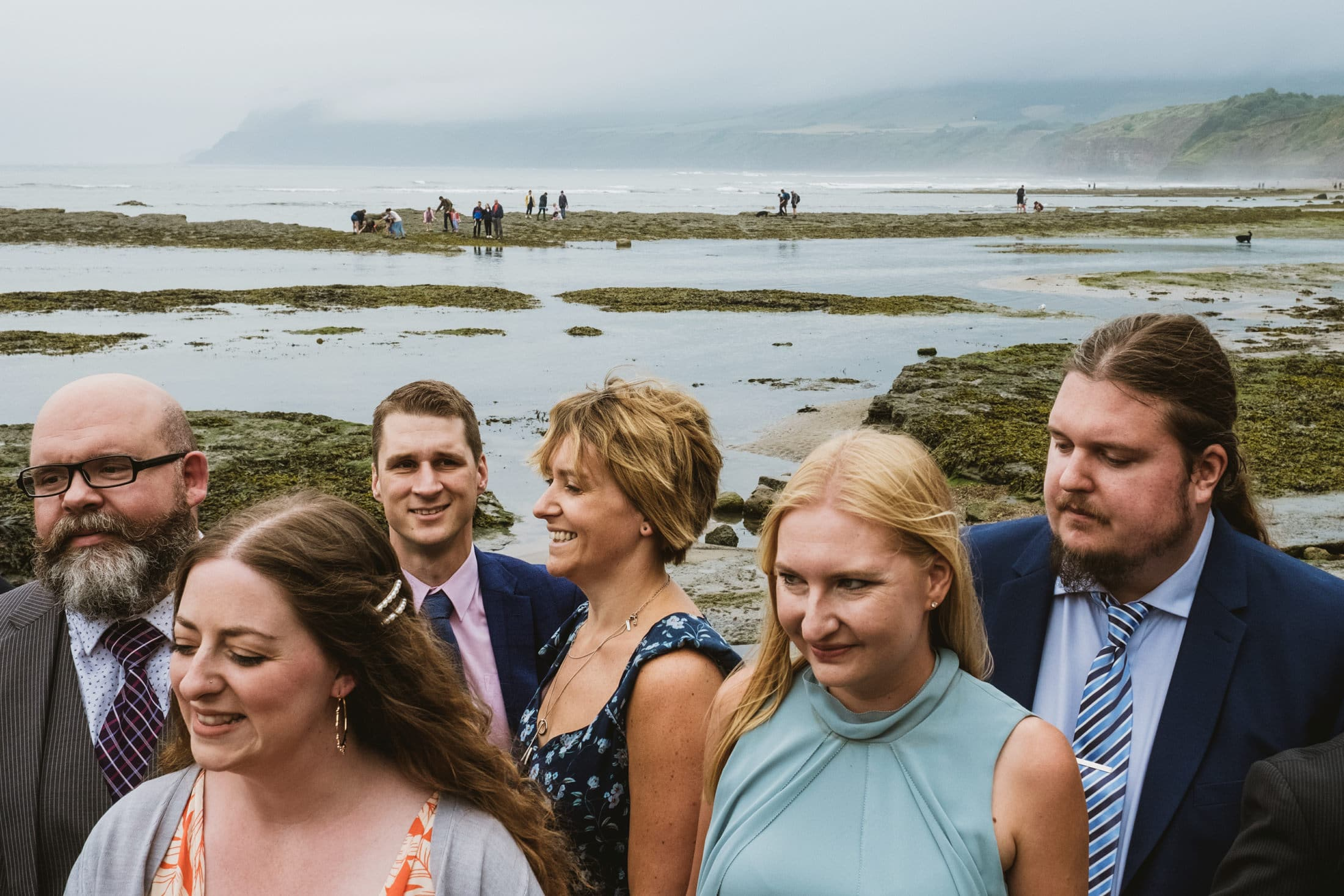 Wedding guests on Robin's Hood beach