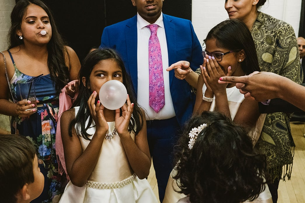 Cecil Sharp House wedding reception in London guests blowing bubble gum