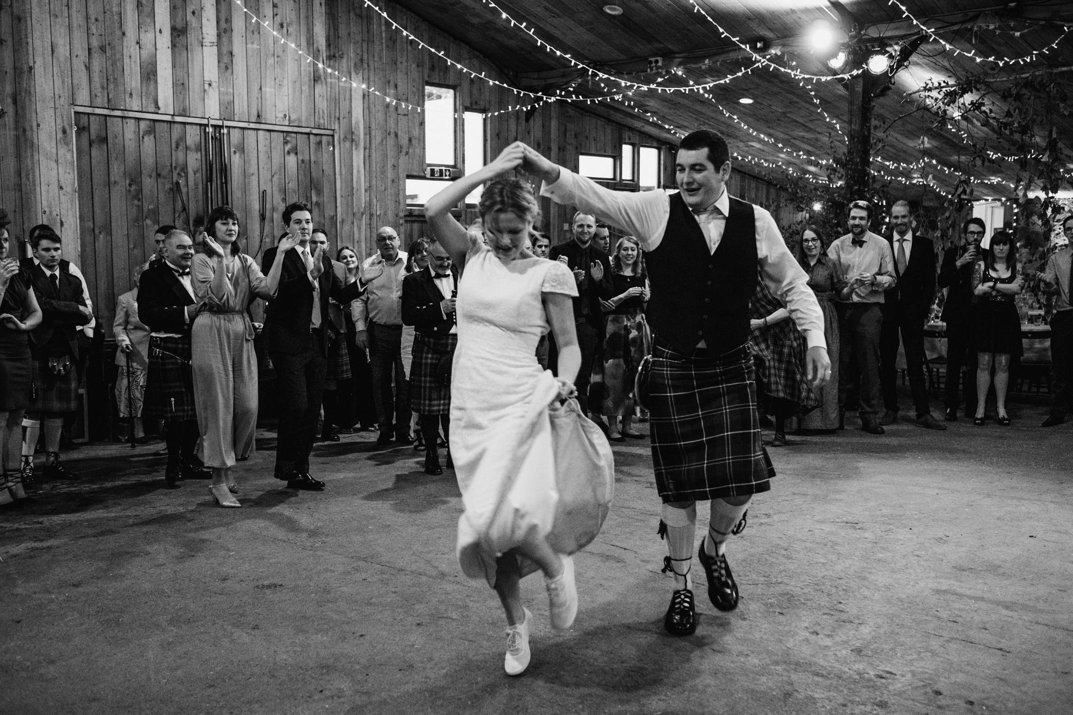 bride and groom dancing the ceilidh