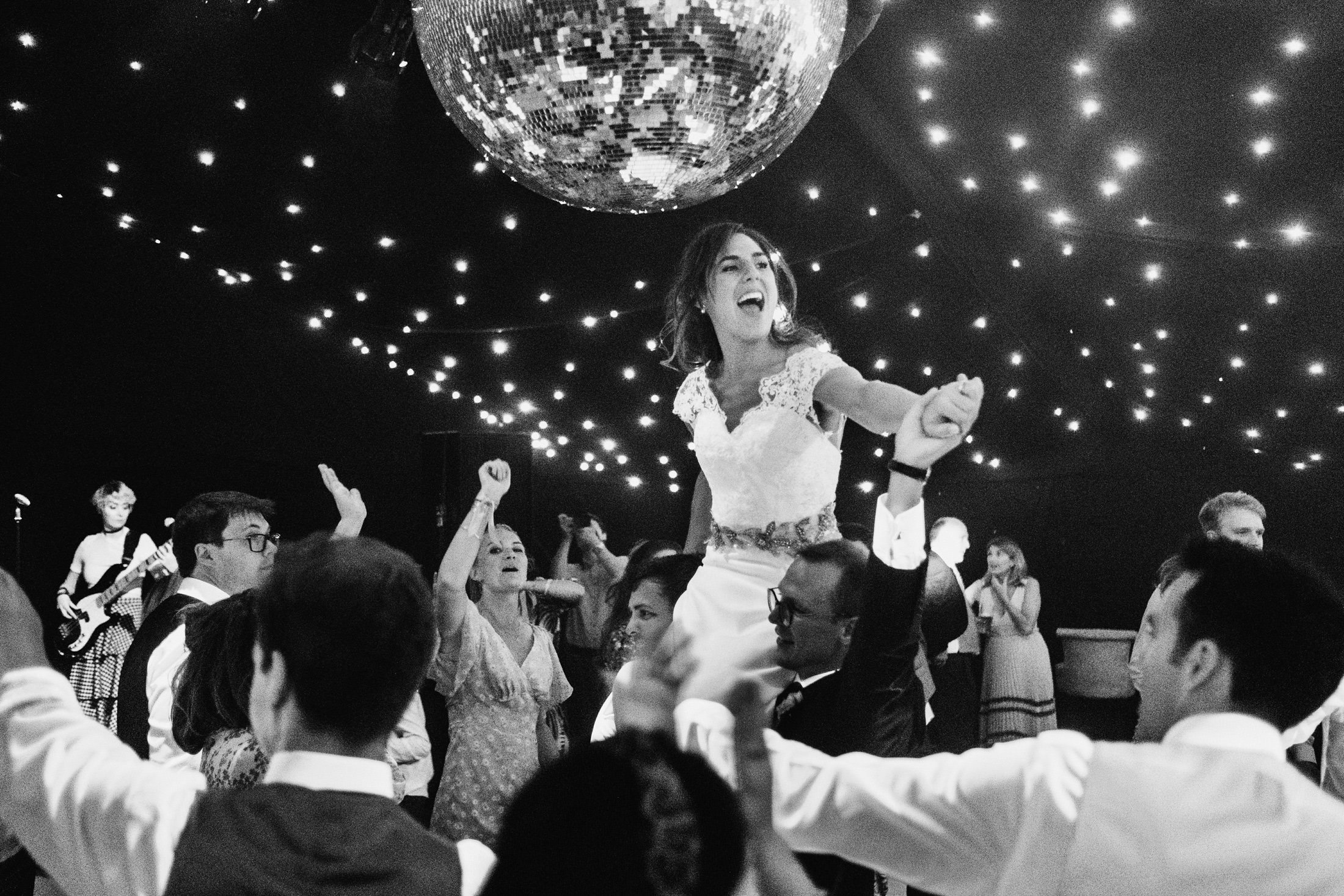 bride on dance floor being lifted into the air
