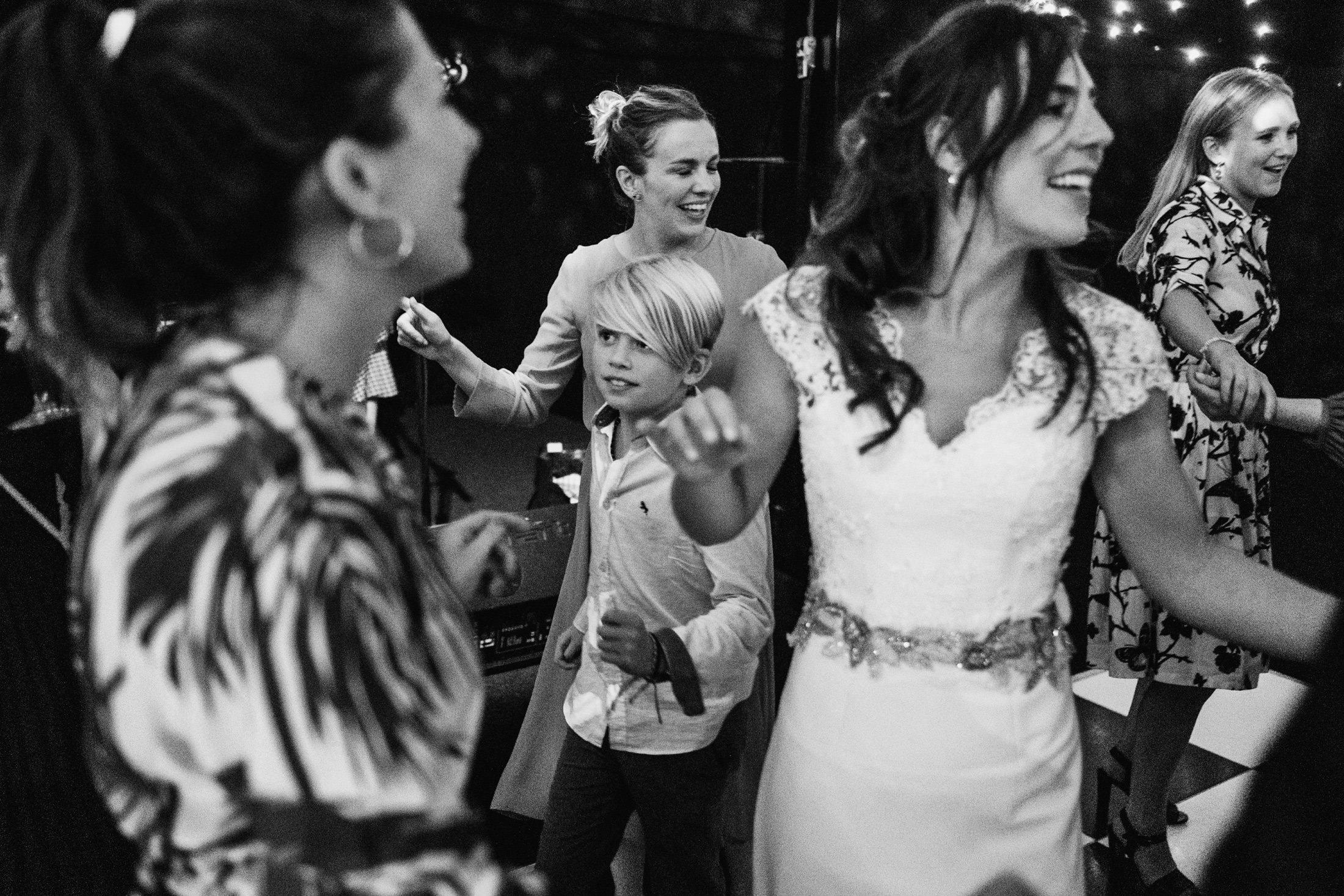bride on dance floor with friends