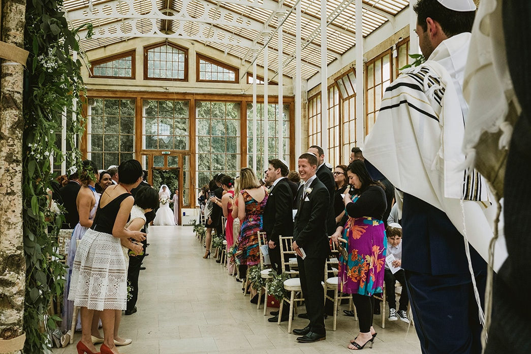 Ceremony at Kew Gardens. The bride's entrance and the groom seeing his bride for the first time.