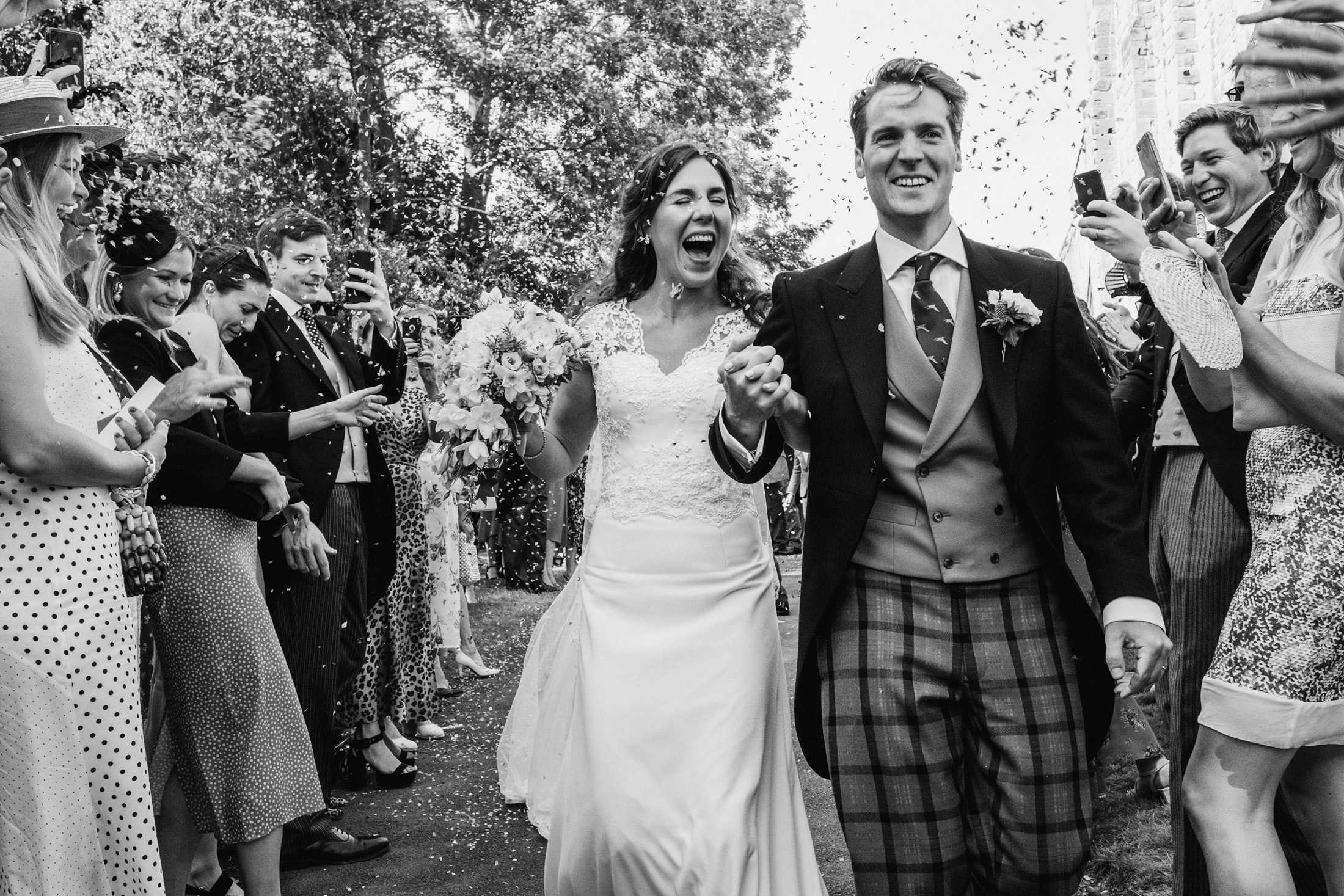 bride and groom cheshire wedding with confetti