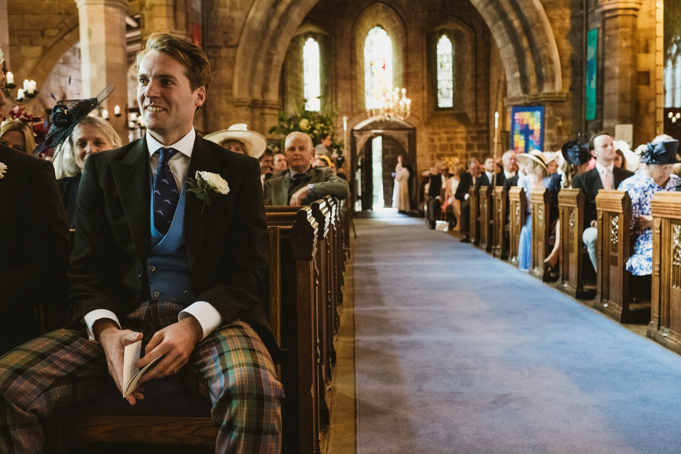 groom waiting for the bride at church in Cheshire
