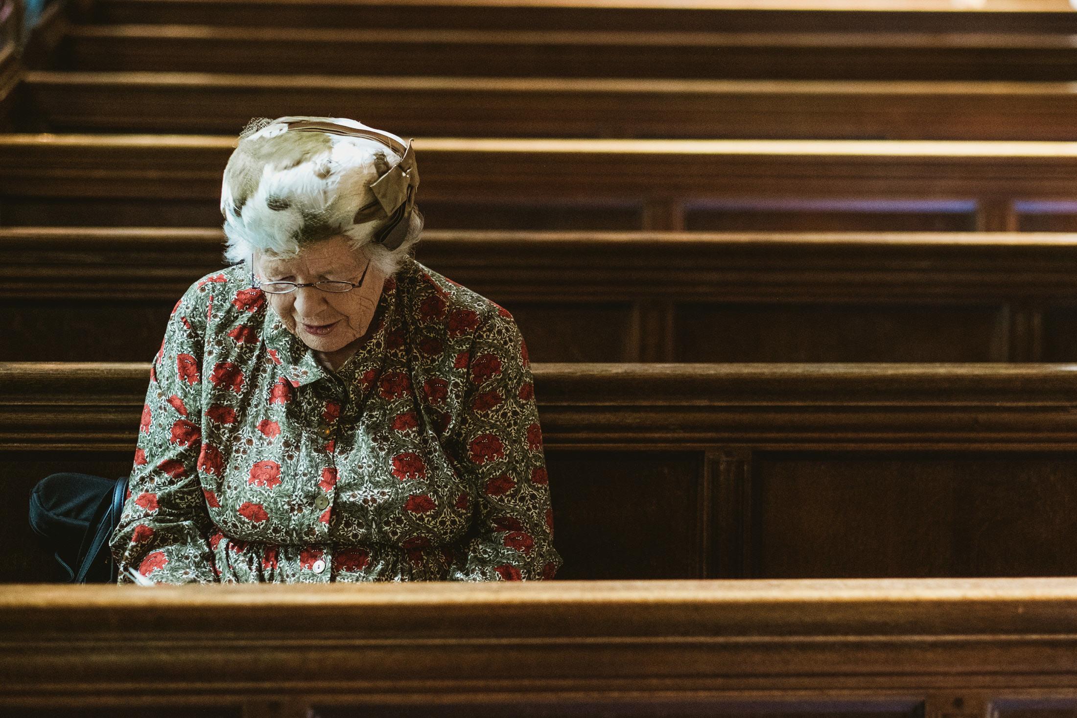 wedding guest sitting in church
