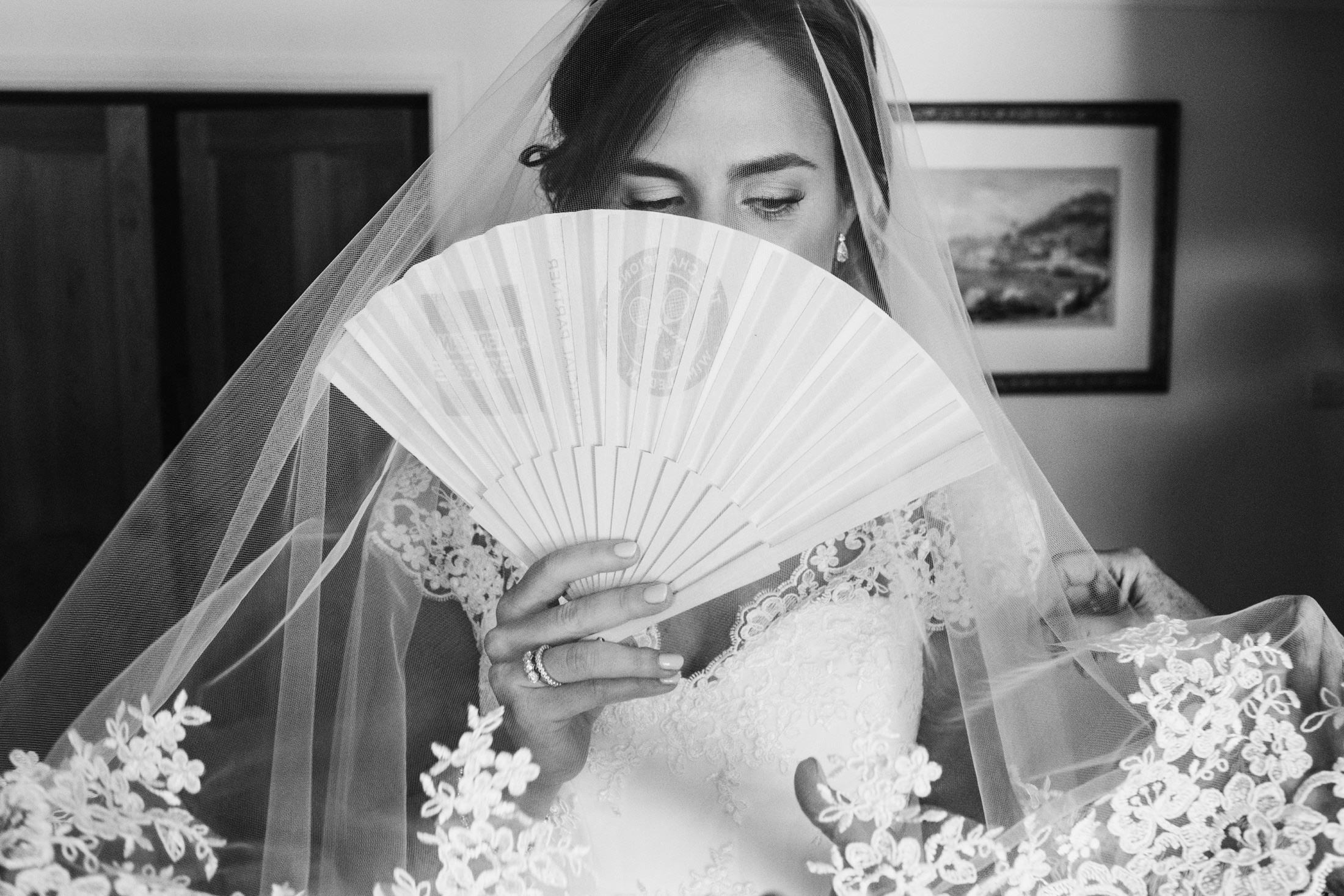 bride with fan, black and white image
