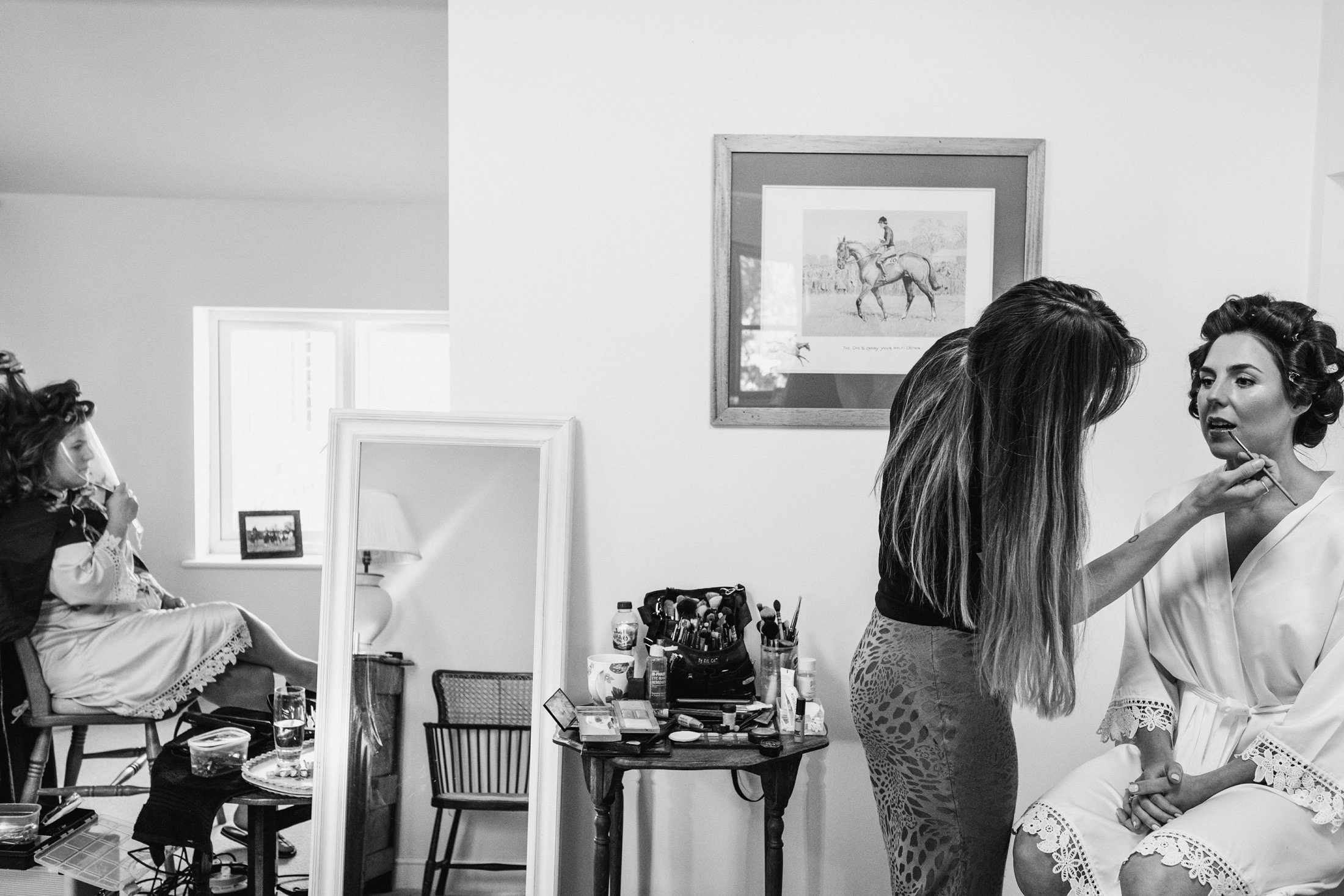 bride having her make up done in the house
