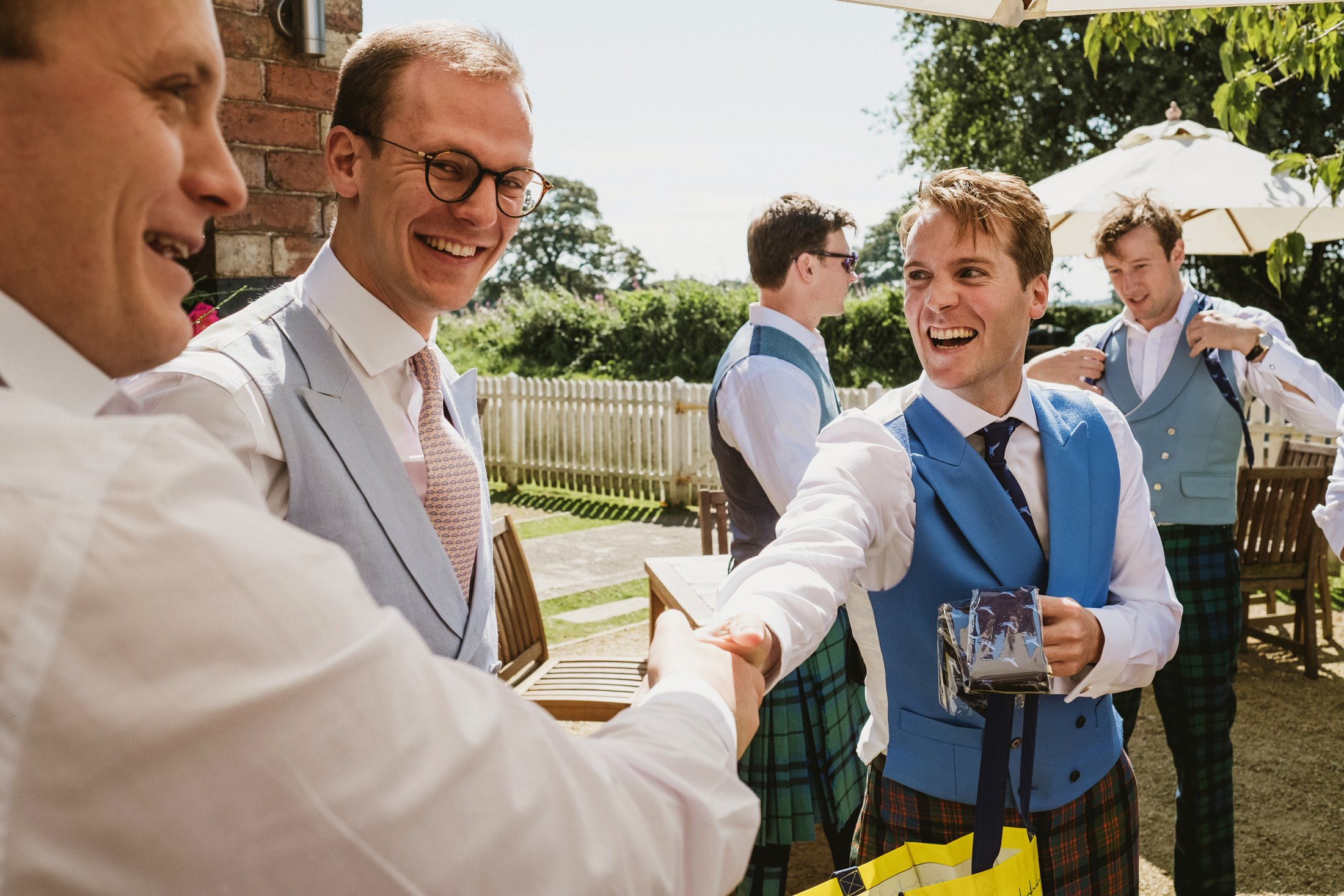groom shaking hands with groomsmen at a Cheshire pub