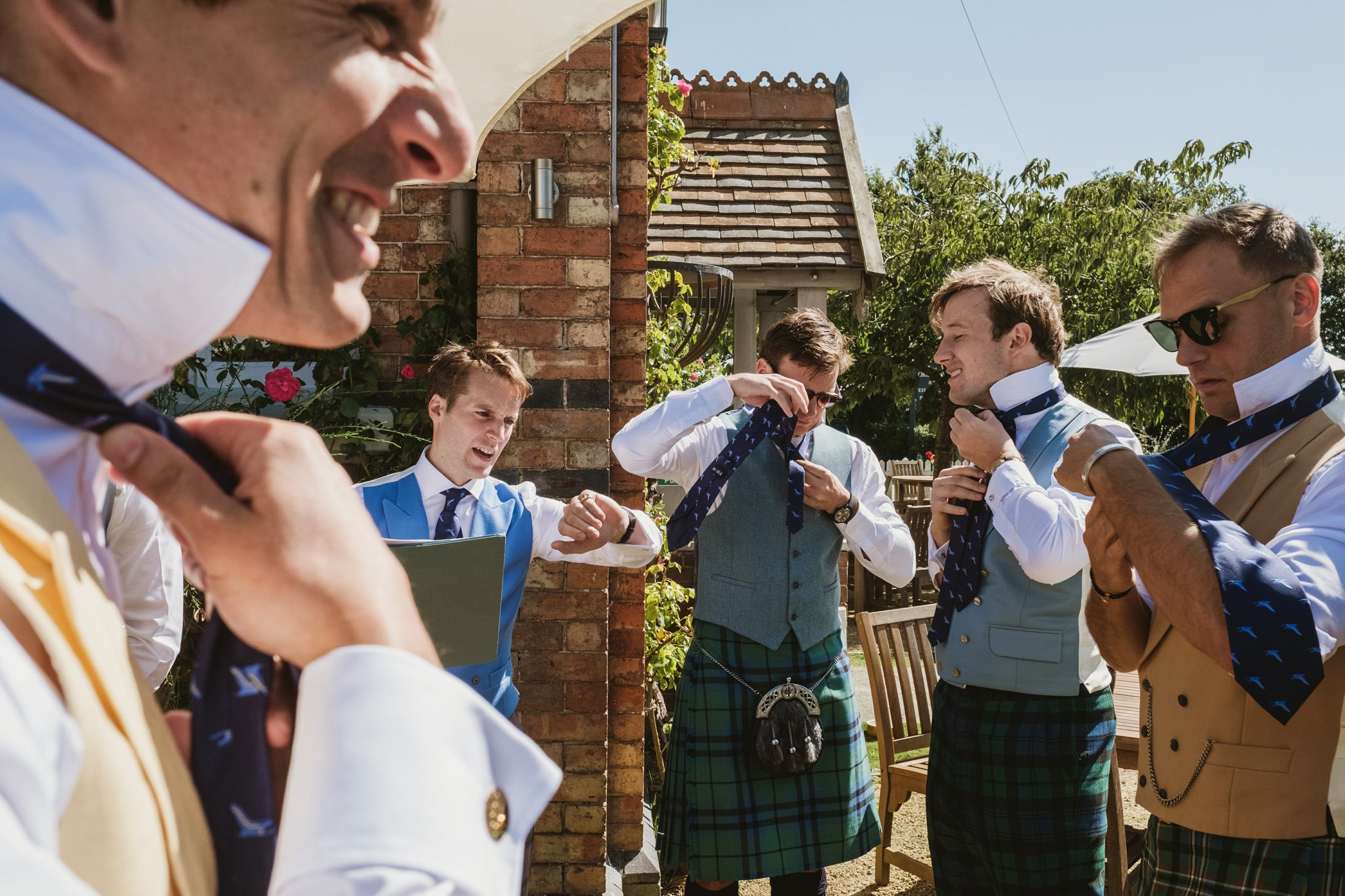 groom and groomsmen getting ready outside at the pub