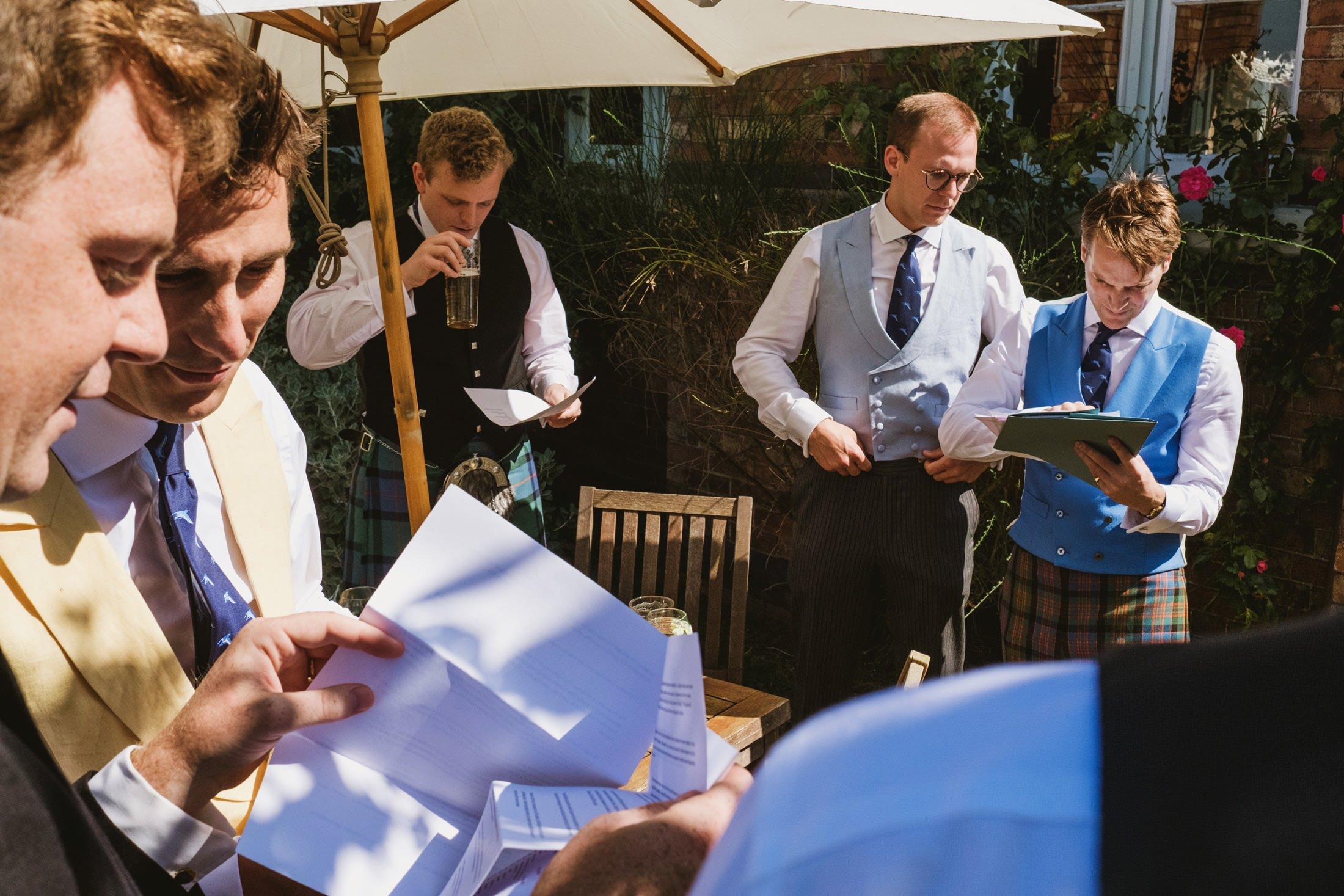 groomsmen and groom checking schedule