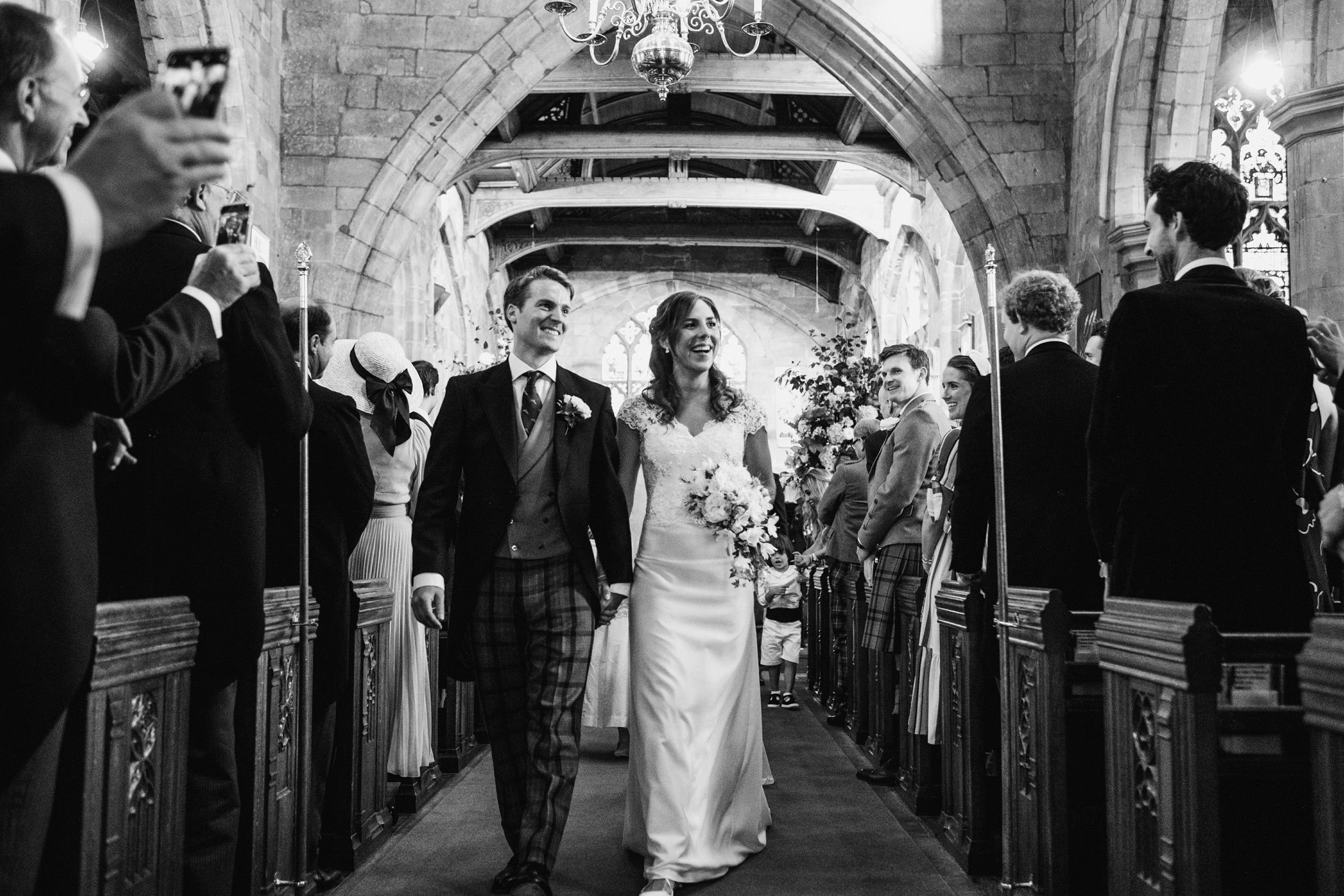 bride and groom leaving the church in Cheshire