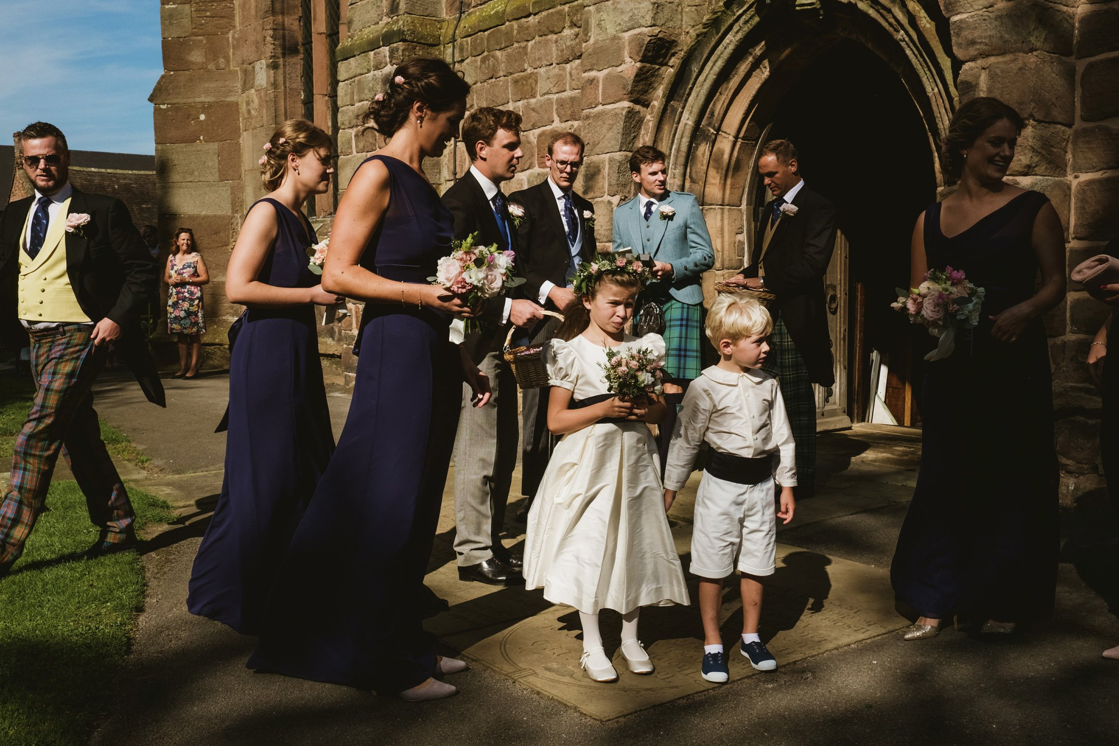 wedding guests outside the church in Cheshire