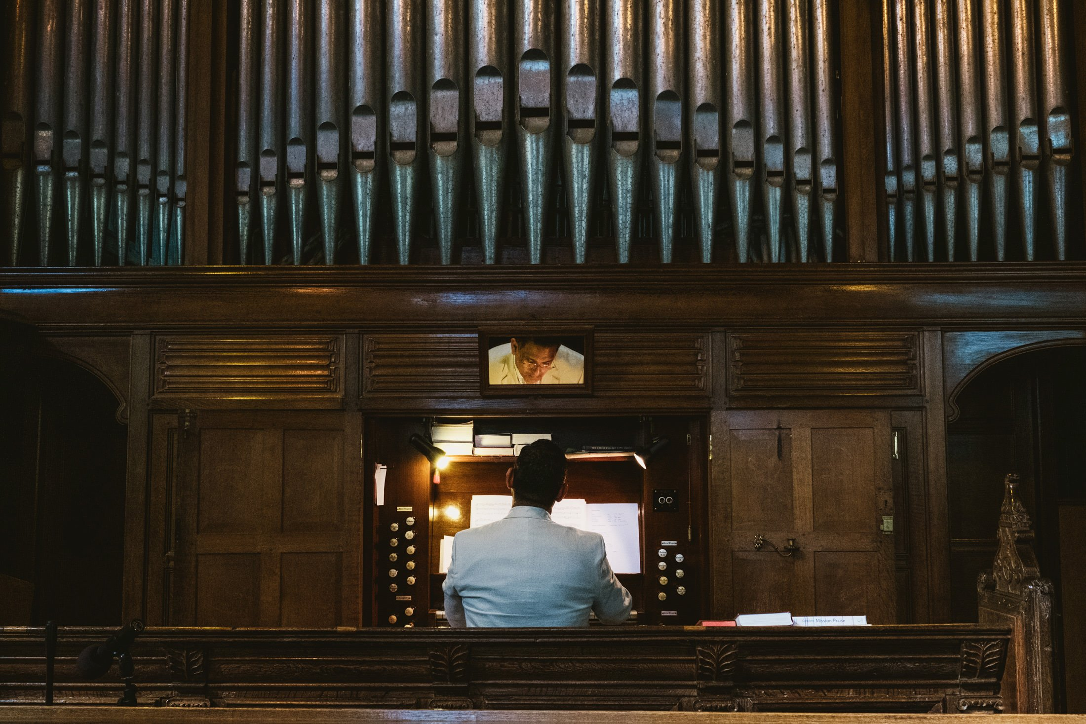 organist playing during wedding ceremony