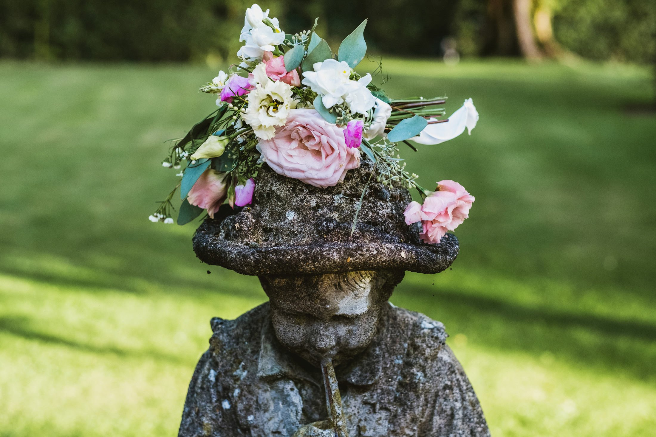 flowers being left on top of a statue
