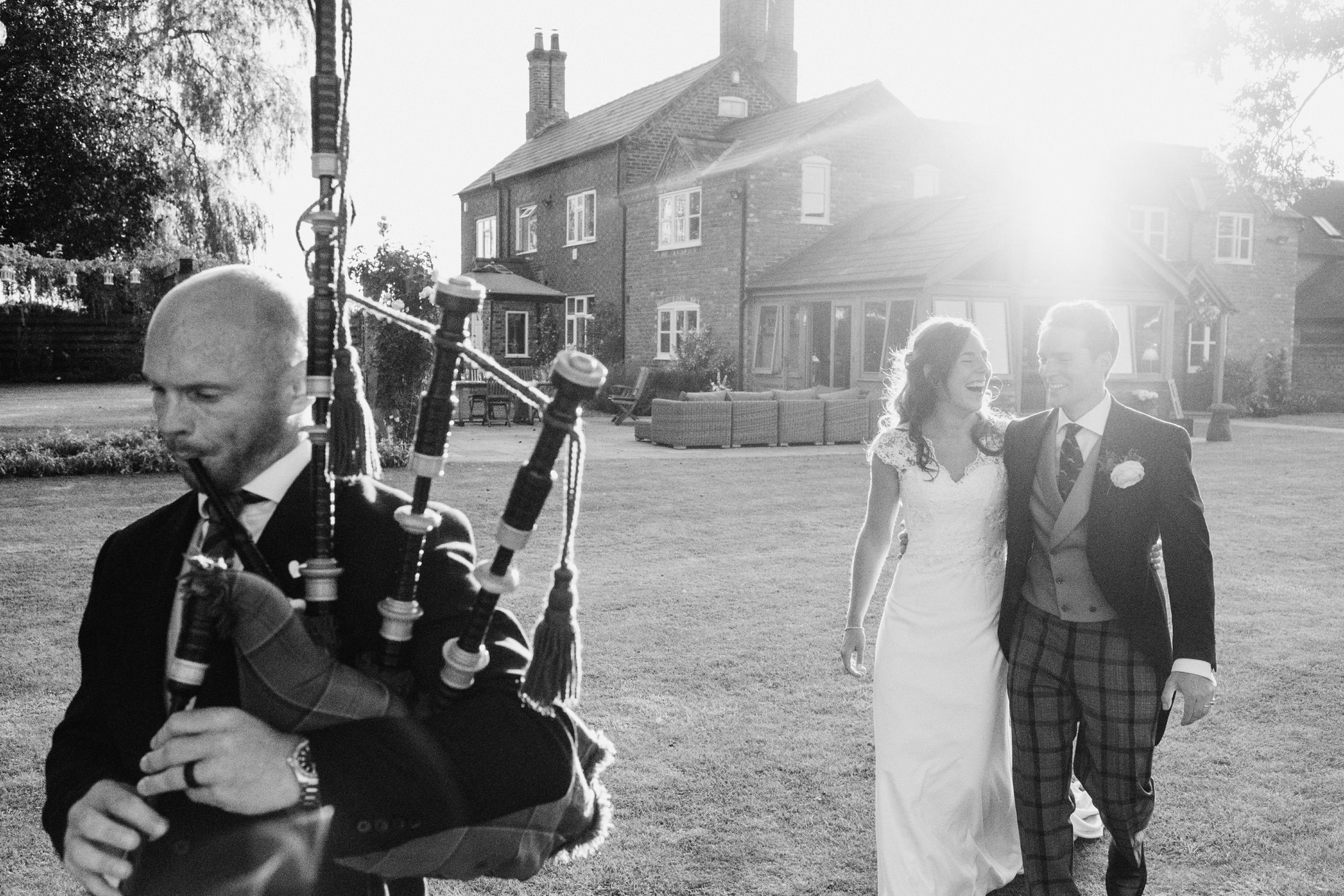 bride and groom wedding entrance with bagpipes