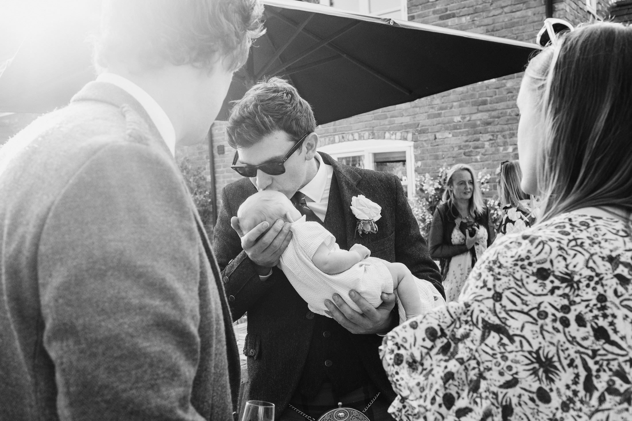 wedding guest kissing baby