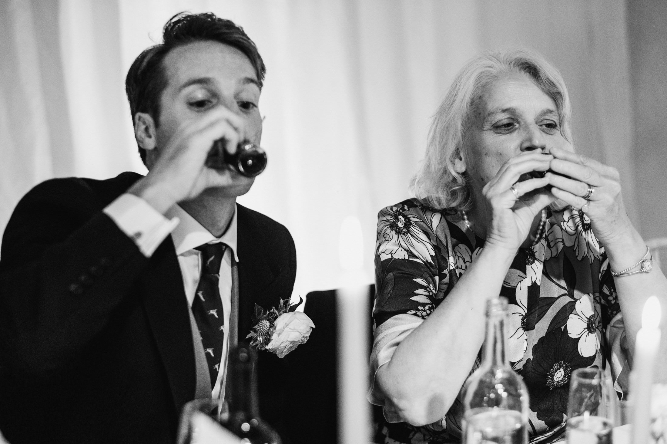 groom and groom's mum having a shot together
