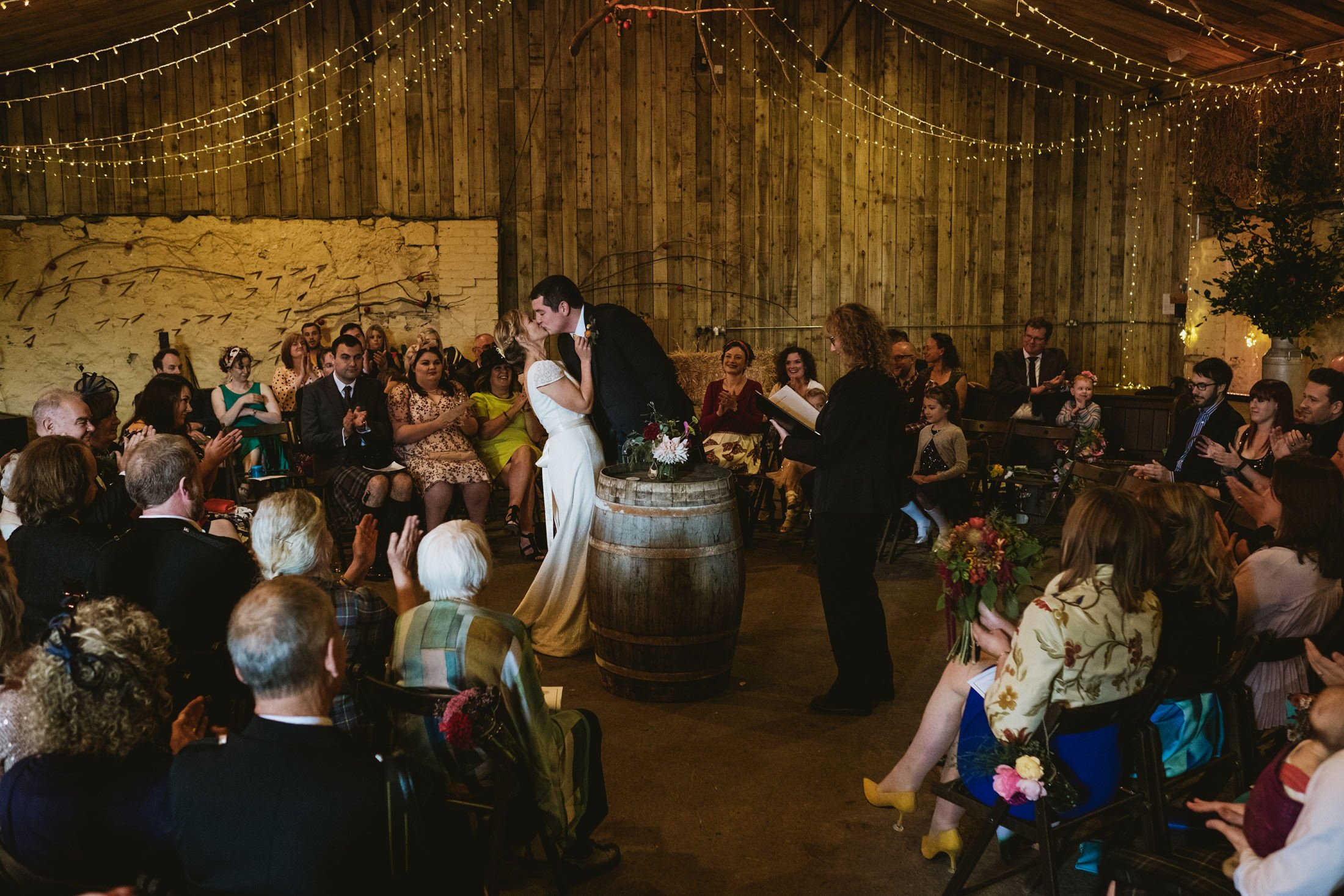 bride and groom's first kiss during the ceremony at Comrie Croft