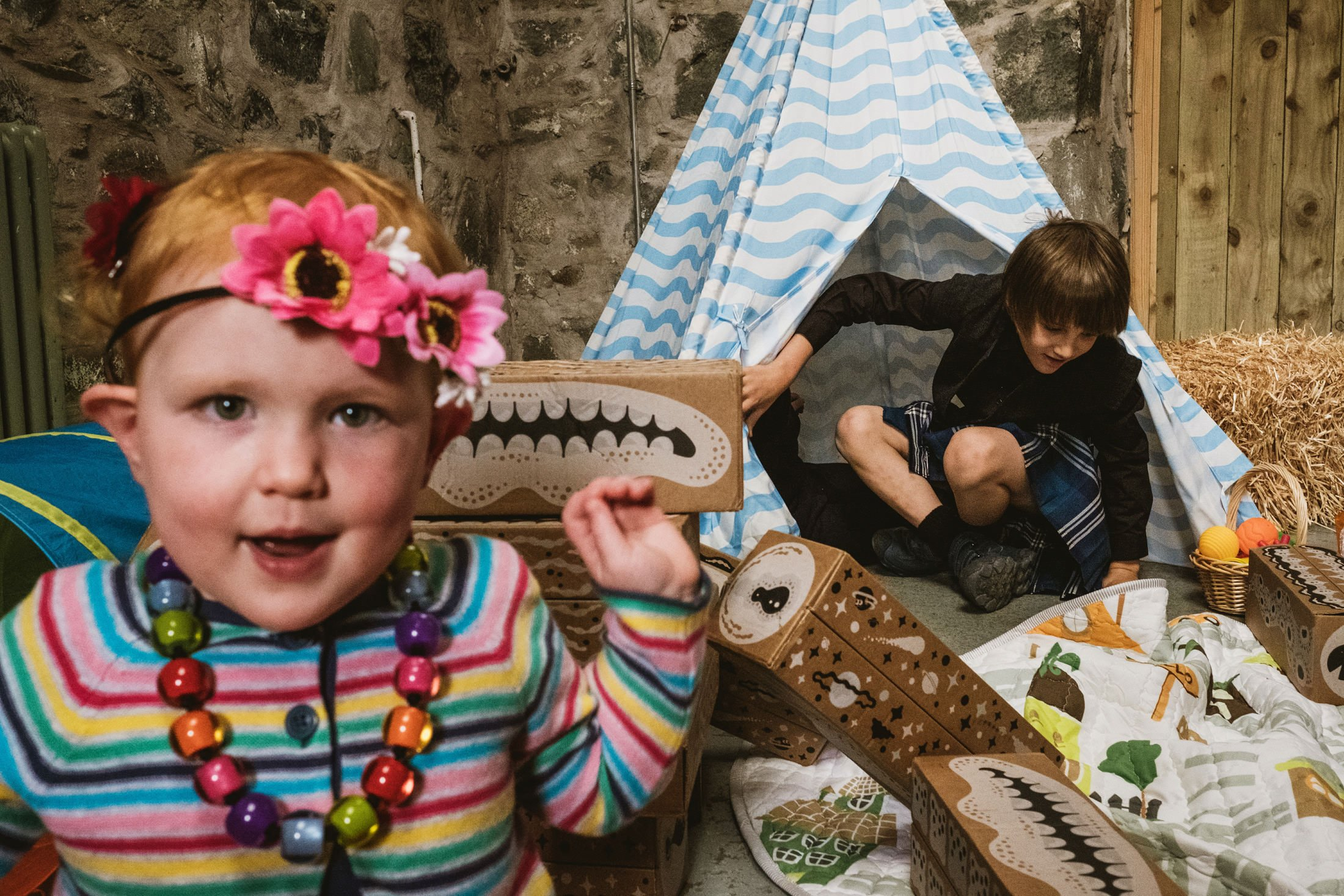 children wedding guests playing in the teepees