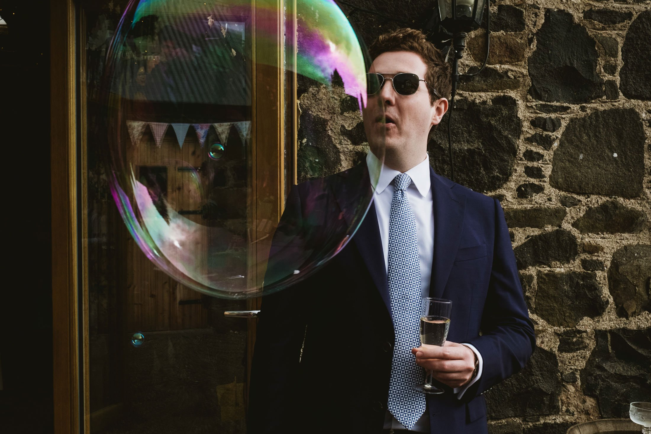 Comrie Croft Wedding Photography, Big bubble and a wedding guest