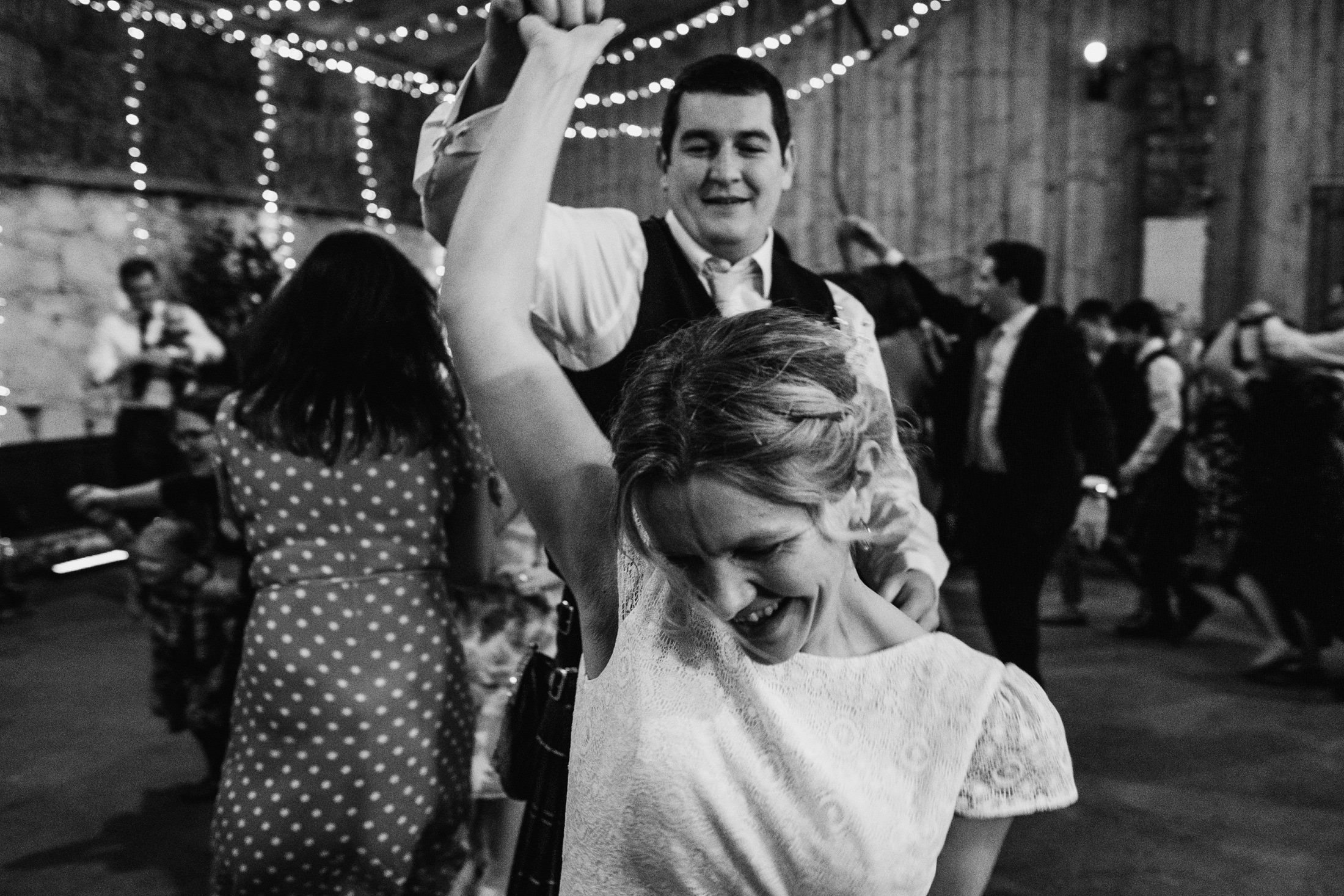 bride and groom dancing at Comrie Croft