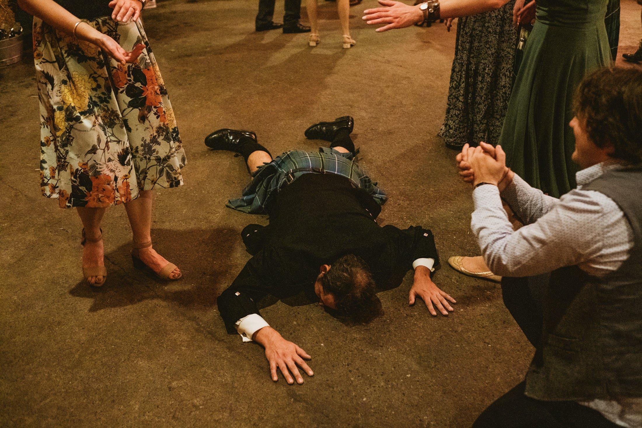 groom on the floor of the dance floor