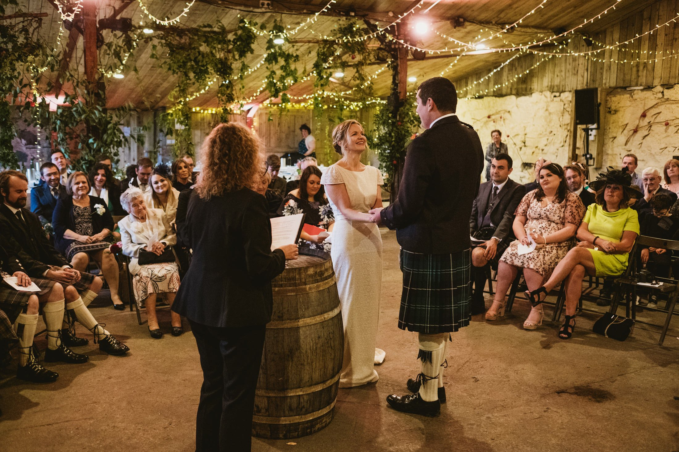 bride and groom giving their vows during the wedding ceremony at Comrie Croft