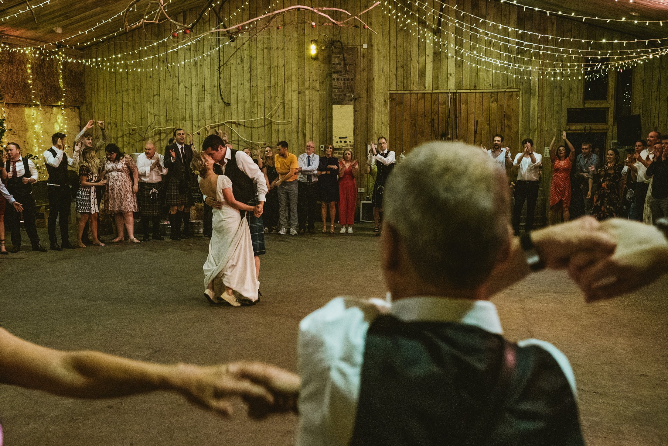 Scottish documentary wedding photography, bride and groom first dance at Comrie Croft